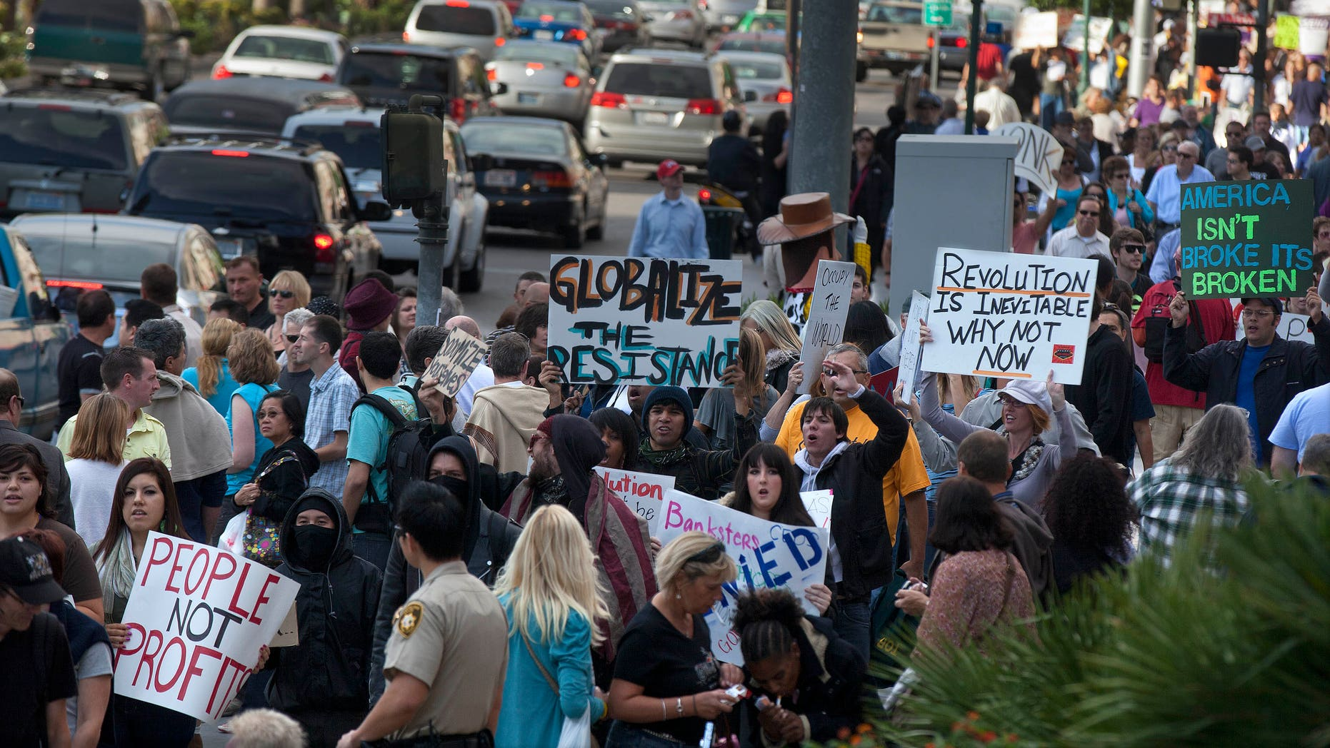 Protestors shout slogans as they participate in an Occupy Wall Street demonstration, Thursday, Oct. 6, 2011, in Las Vegas. Union officials, college students and homeowners facing foreclosure marched down the Las Vegas Strip in support of the Occupy Wall Street demonstrations.