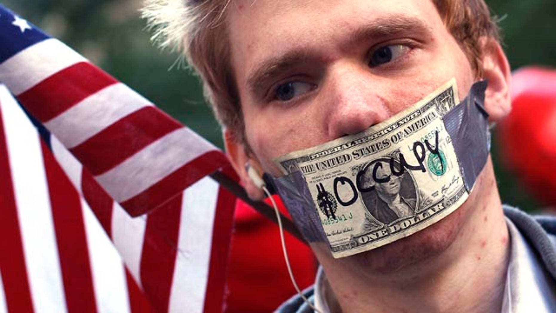Oct. 17, 2011: An Occupy Wall Street campaign demonstrator stands in Zuccotti Park, near Wall Street in New York.