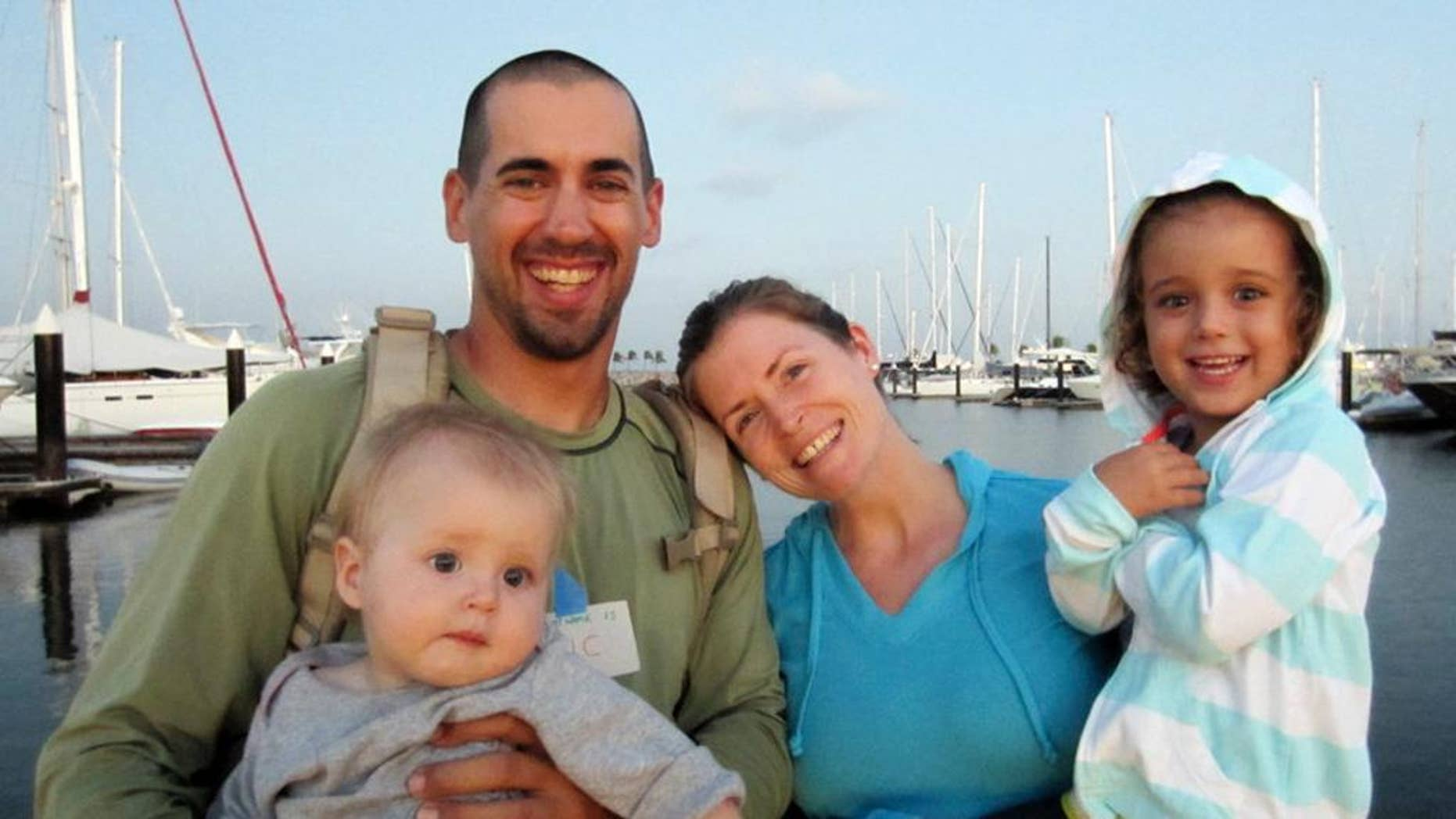 This undated image provided by Sariah English shows Eric and Charlotte Kaufman with their daughters, Lyra, 1, and Cora, 3. Rescuers have stabilized the condition Lyra, with her family on a crippled sailboat hundreds of miles off the coast of Mexico, and a U.S. Navy warship was headed toward the vessel, officials said Friday night, April 4, 2014. Their boat, the 36-foot Rebel Heart, was about 900 nautical miles southwest of Cabo San Lucas when they sent a satellite call for help to the U.S. Coast Guard Thursday morning saying their 1-year-old girl aboard was ill. (AP Photo/Sariah English)