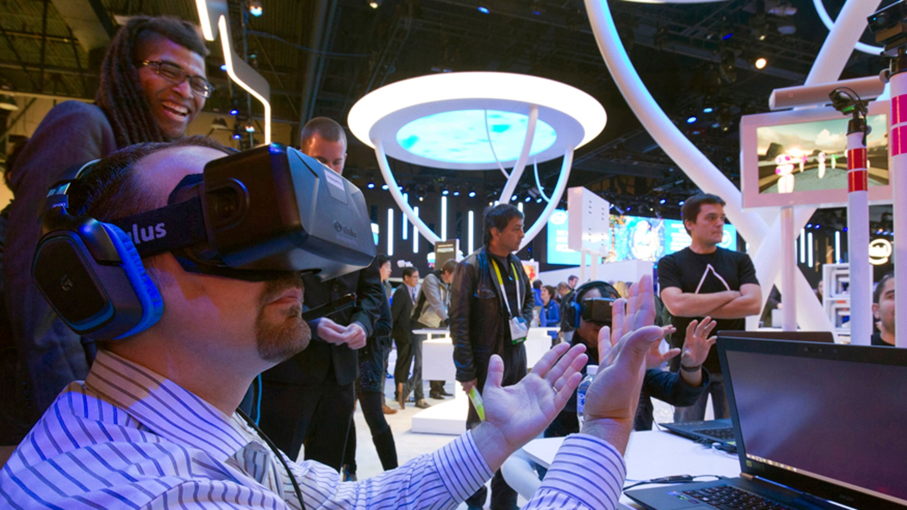 File photo - An attendee wearing an Oculus Rift virtual reality headset plays in a virtual volleyball game at the Intel booth during the 2015 International Consumer Electronics Show (CES) in Las Vegas, Nevada Jan. 6, 2015.