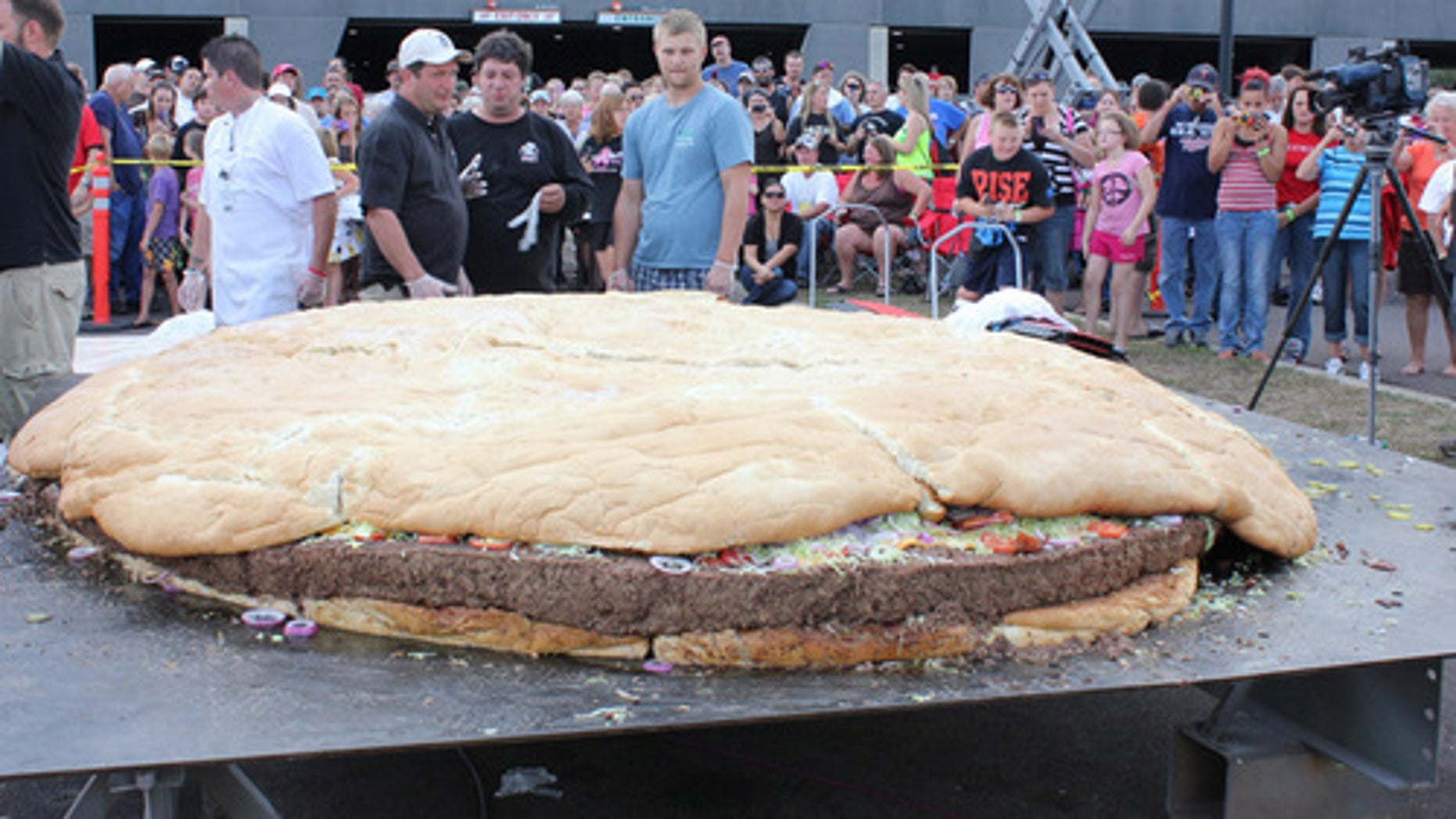 Sept. 2, 2012: People examine a bacon cheeseburger measuring 10 feet in diameter and weighing 2,014 pounds at Black Bear Casino Resort near Carlton, Minn.