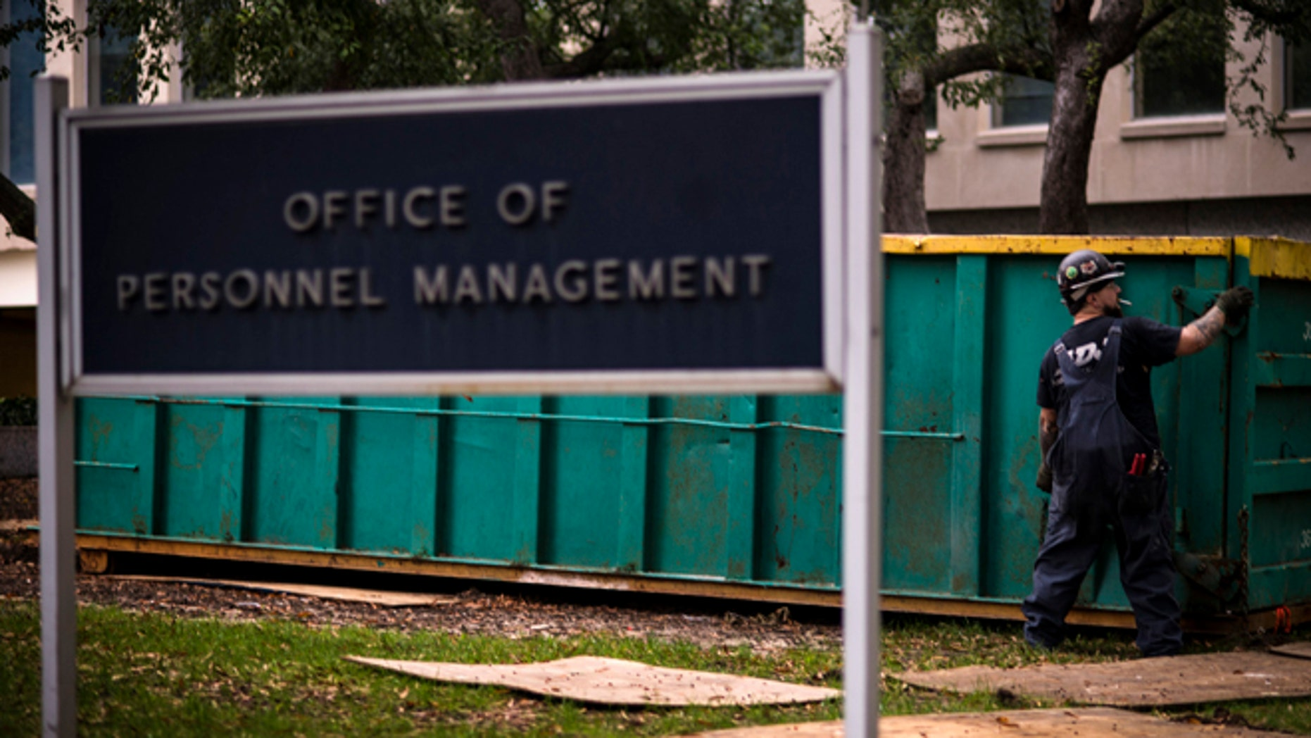In this Thursday, Oct. 17, 2013 photo, a worker is seen at the Office of Personnel Management in Washington.