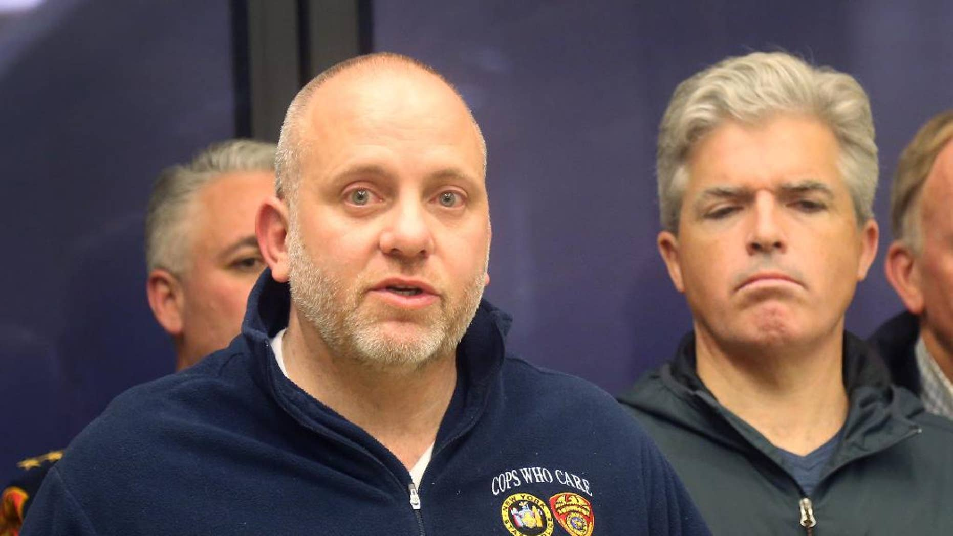Noel DiGerolamo, left, President of the Suffolk County Police Benevolent Association, and Suffolk County Executive Steven Bellone, speak with reporters at a news conference at Stony Brook University Hospital, Thursday, March 12, 2015 in Stony Brook, N.Y. A Suffolk County police officer was shot and wounded while confronting a suspect who fled a traffic stop, police officials said. Officer Mark Collins, who is expected to survive, was in plain-clothes and driving an unmarked vehicle when he stopped a car for a vehicle and traffic violation on Route 25 in Huntington Station. A suspect is in custody. (AP Photo/Mike Balsamo)