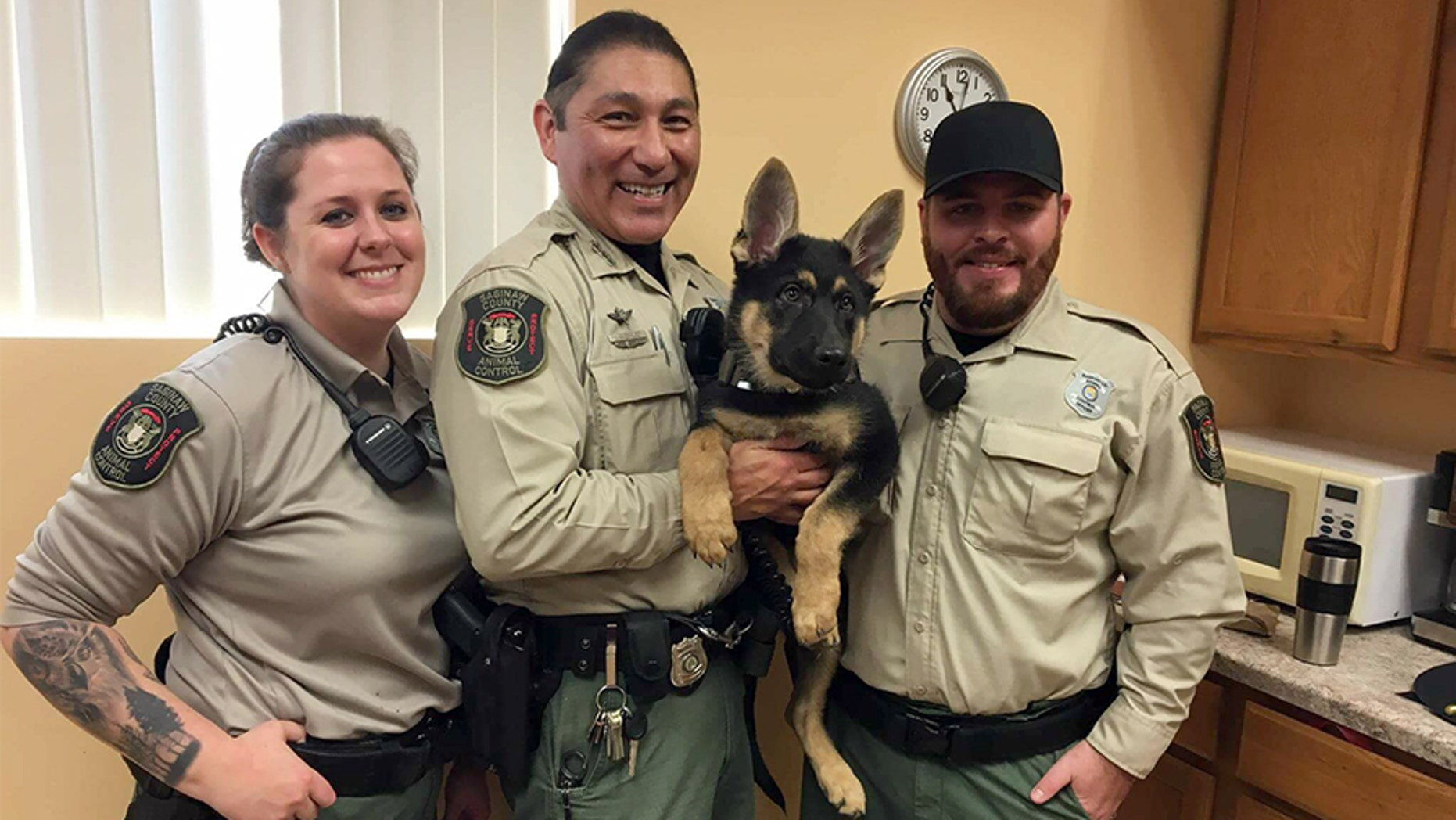 From left to right, Officer Trish Barnes, Officer Joaquin Guerrero and Officer Anthony Trevino will sleep outside on Jan. 12 to raise awareness of the dangers animals face when they're left outside for long periods of time. Seen with them is Guerrero's canine partner, Little Chief.