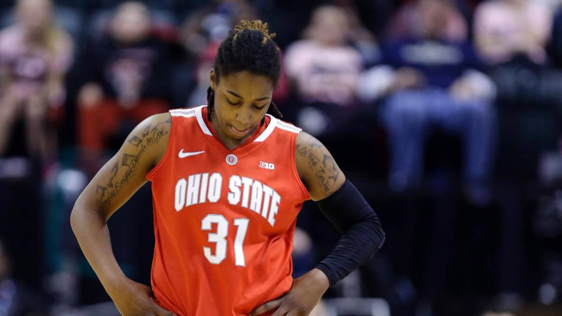 FILE - In this March 8, 2014, file photo, Ohio State guard Raven Ferguson leaves the games after fouling out in the second half of an NCAA college basketball game against the Iowa in the semifinals of the Big Ten women's tournament in Indianapolis. Second-year Ohio State coach Kevin McGuff has dismissed second-leading scorer Raven Ferguson from the team, citing a violation of team rules. McGuff said he would address the dismissal at the team's media day later on Thursday, Oct. 2, 2014. (AP Photo/Michael Conroy, File)