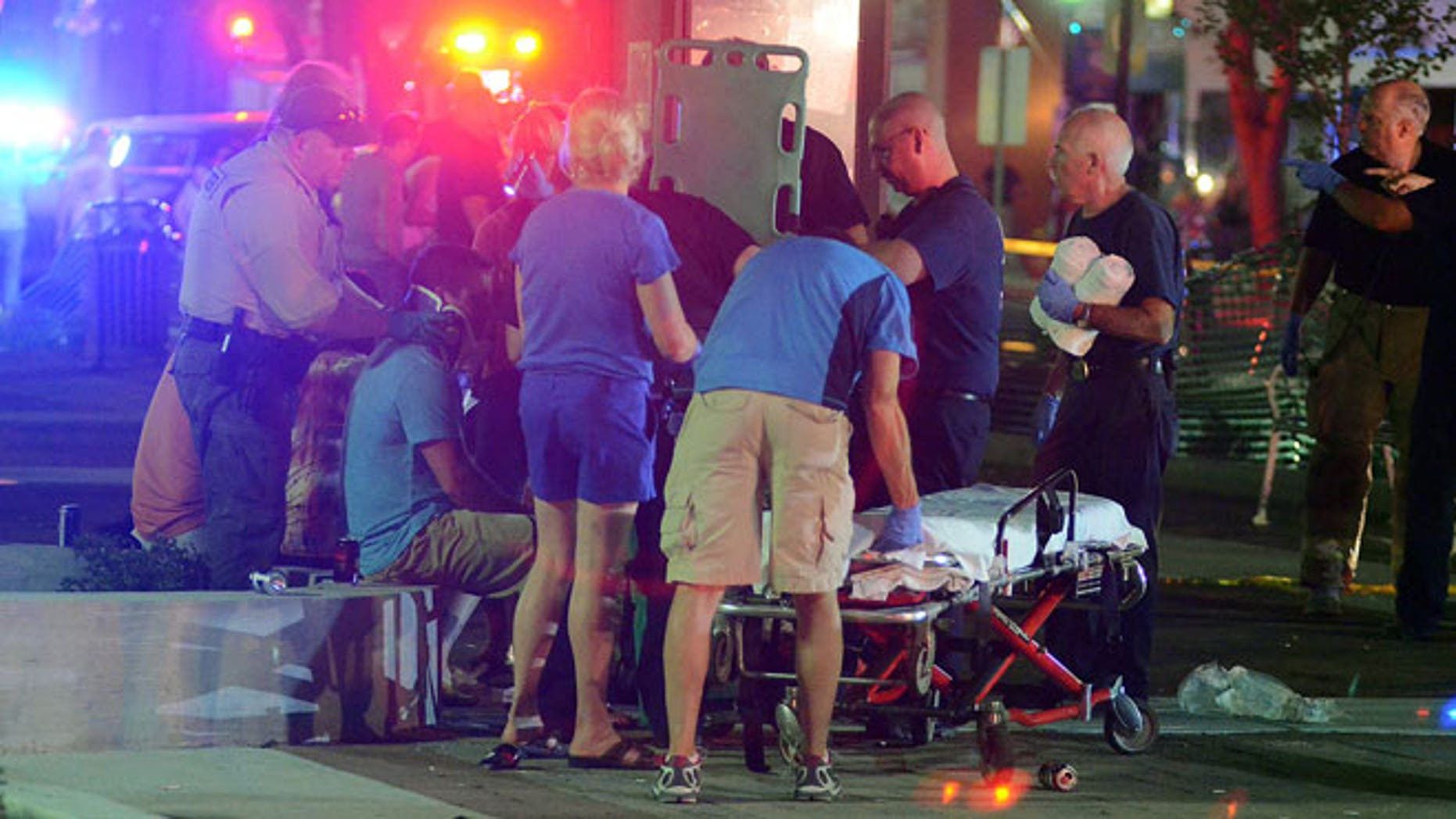 June 15, 2012: Emergency workers treat injured bystanders after a motorist drove into the Rally n Lima's Town Square in Lima, Ohio.