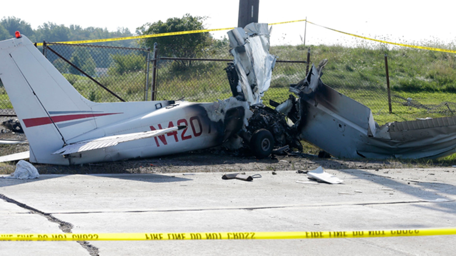 Aug. 26: The wreckage from a plane that crashed rests on the side of a road in Richmond Heights, Ohio.
