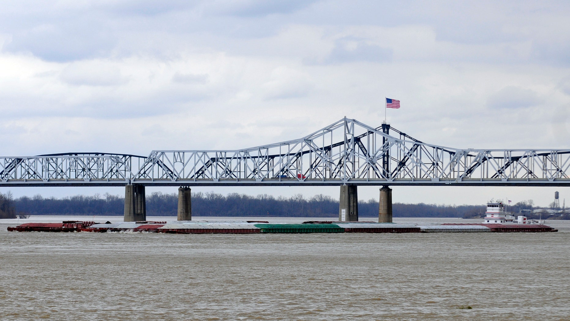 Jan. 30, 2013: The towboat Harold B. Dodd pilots south on the Mississippi River as vehicles cross the Interstate 20 bridge in Vicksburg, Miss.
