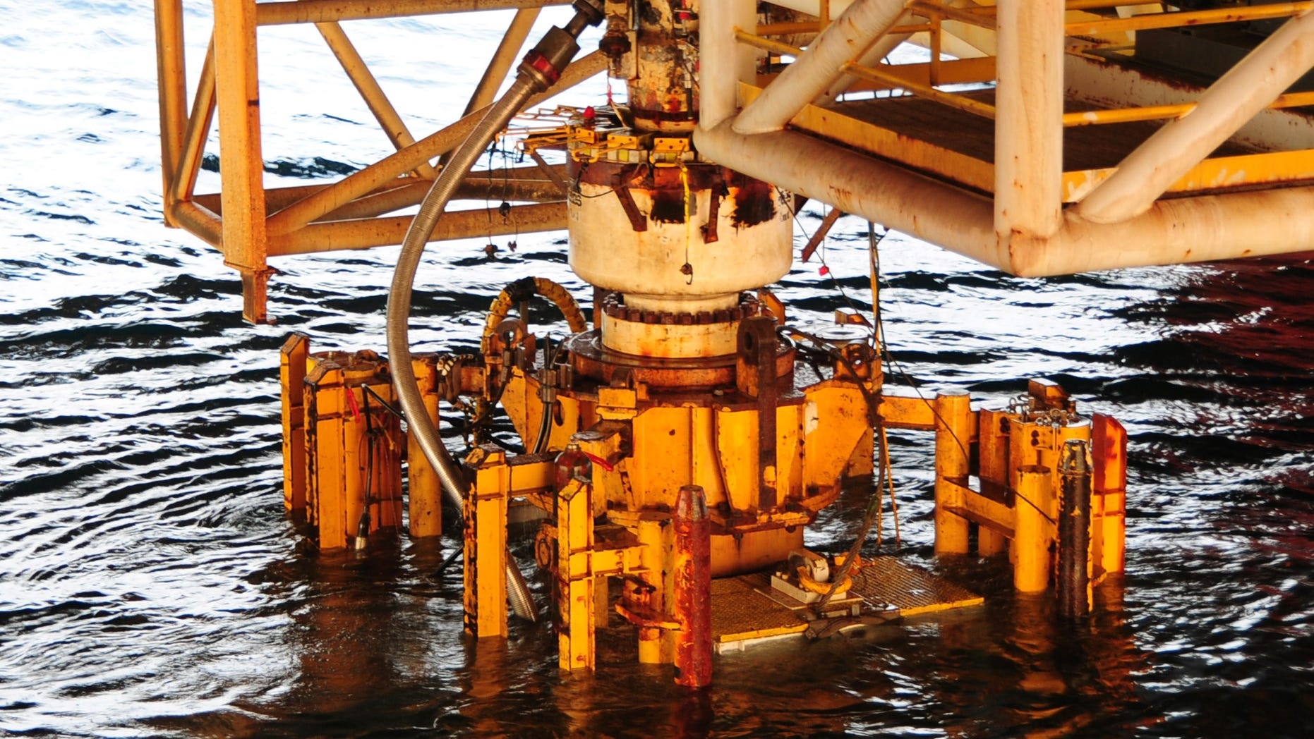 GULF OF MEXICO - SEPTEMBER 4: (EDITORS NOTE: Image has been released by U.S. Military prior to transmission.)  In this handout image provided by the U.S. Coast Guard, the damaged blow out preventer along with the Lower Marine Riser Package (LMRP) cap from the Deepwater Horizon oil rig that caused the massive oil spill is extracted and put aboard the vessel Q4000 on September 4, 2010 in the Gulf of Mexico.  The 50-foot, 300-ton preventer was removed and replaced on the well head by a newly tested preventer and will be taken for evidence to a NASA facility in Louisiana in the ongoing investigation with the Deepwater Horizon Criminal Investigation Team and FBI Evidence Recovery Team.  (Photo by Petty Officer 1st Class Thomas M. Blue/U.S. Coast Guard via Getty Images)