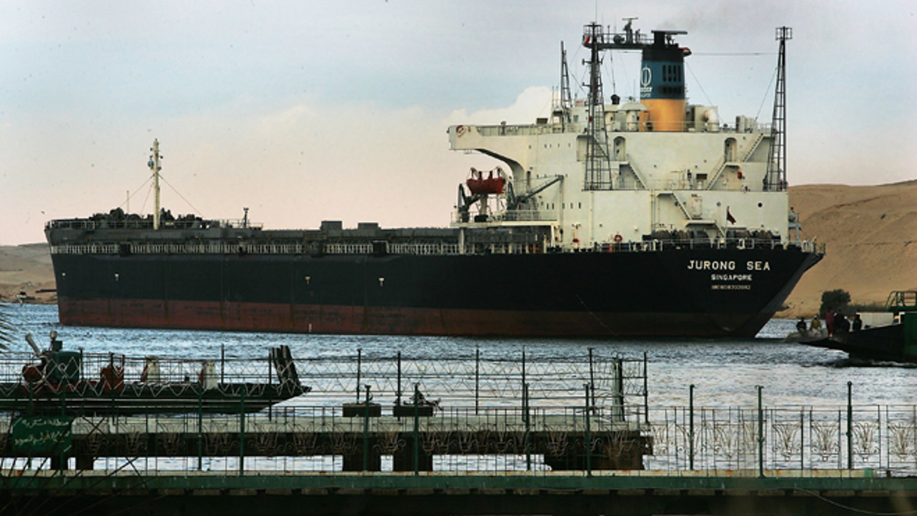 An international oil tanker passes through the Suez canal in Ismailia, Egypt December 14, 2004.  (Photo by Scott Nelson/Getty Images)
