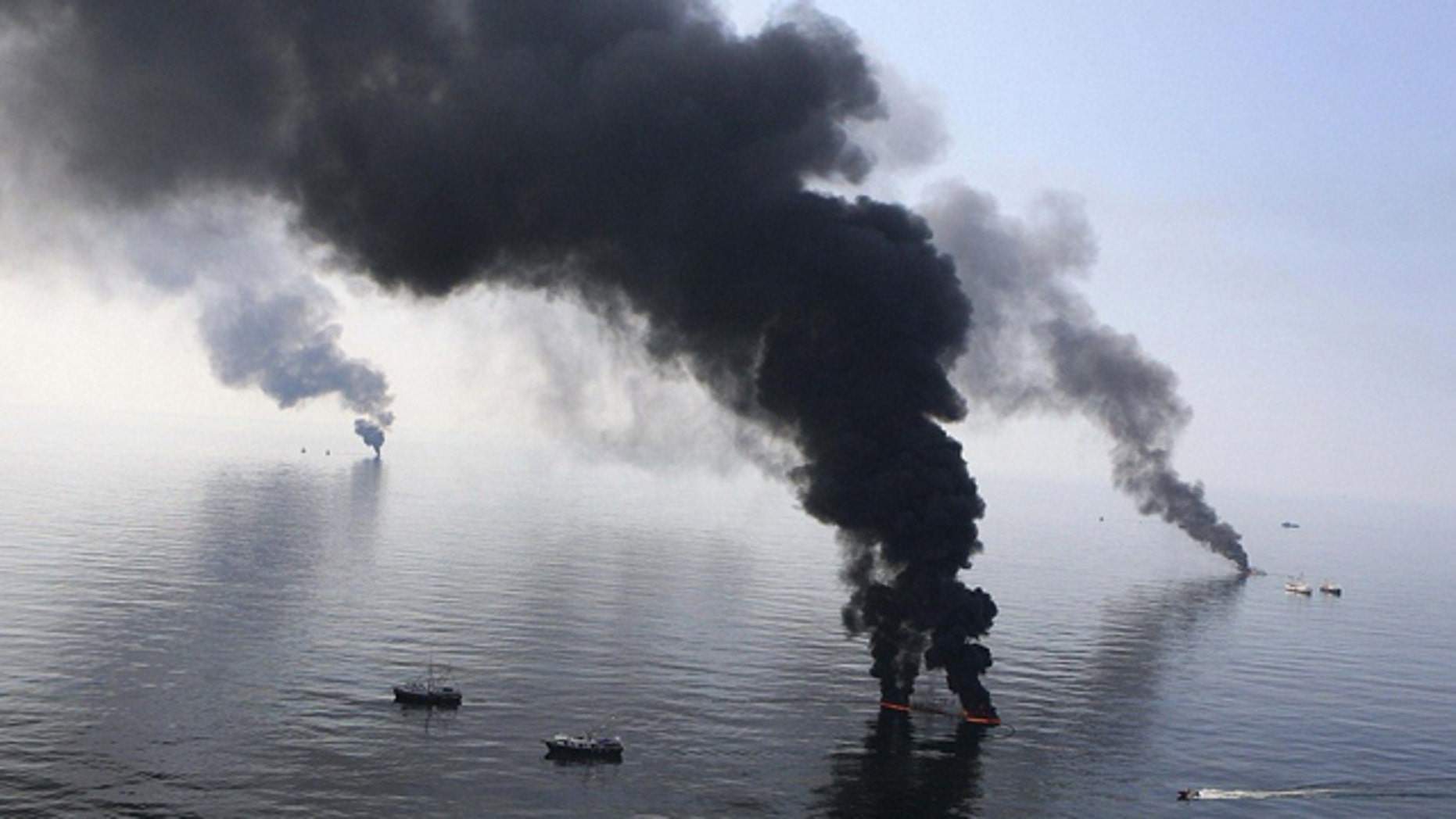 FILE June 2010: Smoke billows from a controlled burn of spilled oil off the Louisiana coast.