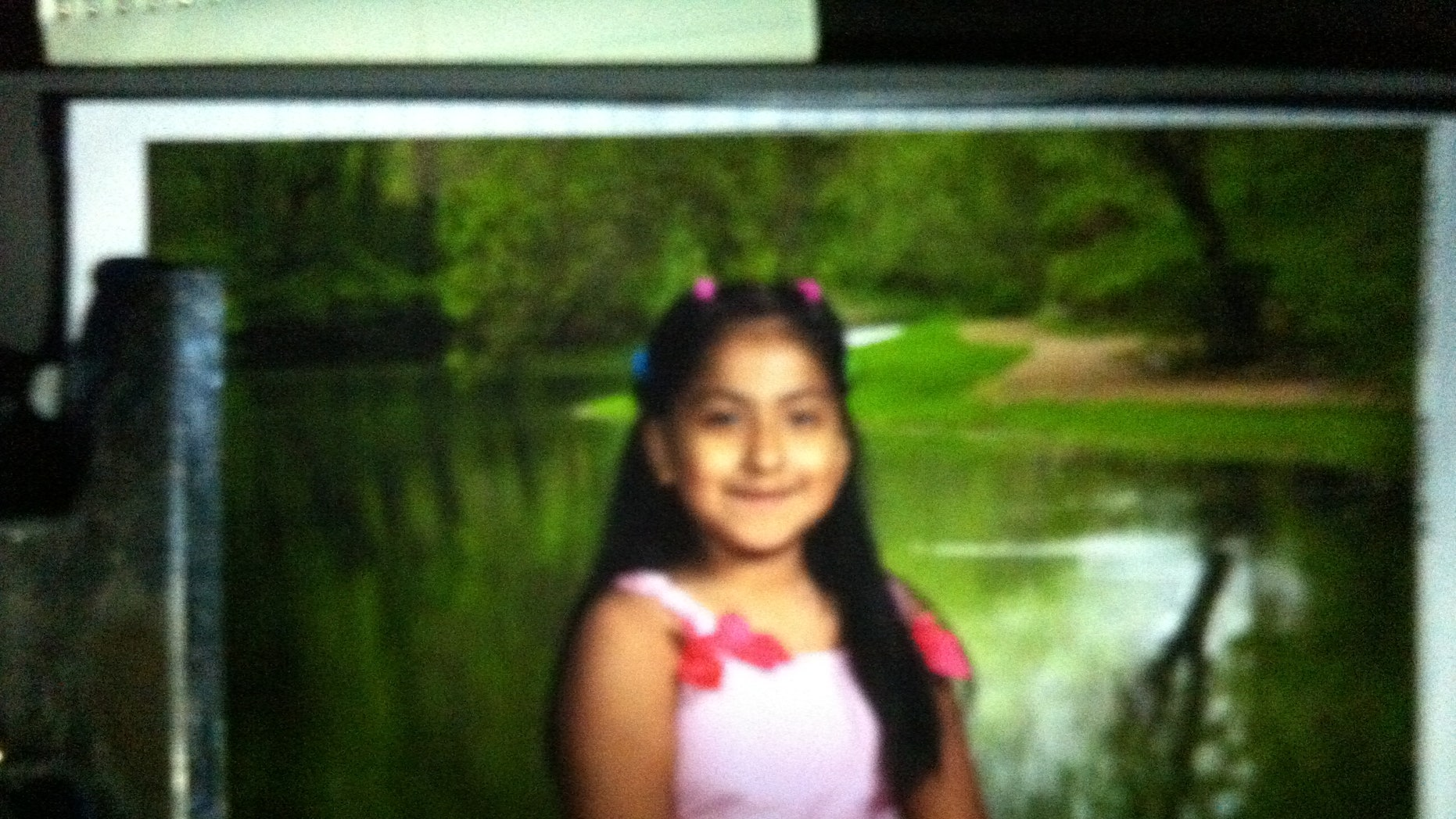 This photo provided by the Oklahoma Department of Public Safety, shows Montserrat Aguirre. An Amber Alert has been issued for the 8-year-old Aguirre, of Tulsa, who was apparently snatched by a motorist from outside an apartment. Aguirre was playing on a swing set at about 7:20 p.m. Sunday, May 4, 2014, when a small white car pulled up and a white man got out, grabbed her and put her in the car before driving away. (AP/Oklahoma Department of Public Safety)