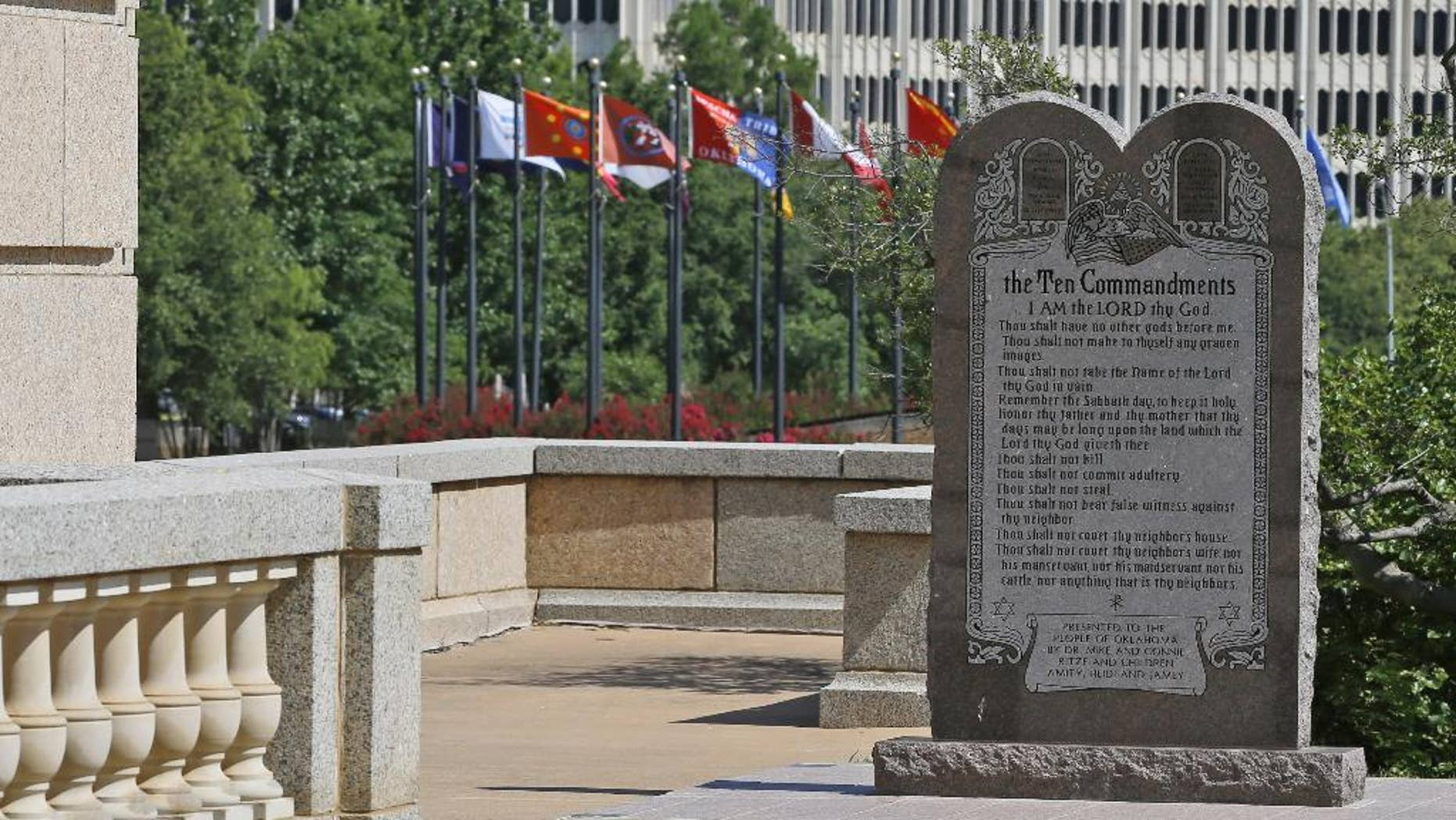 The Ten Commandments monument is pictured at the state Capitol in Oklahoma City, Tuesday, June 30, 2015. Oklahoma's Supreme Court says the monument must be removed because it indirectly benefits the Jewish and Christian faiths in violation of the state constitution. (AP Photo/Sue Ogrocki)