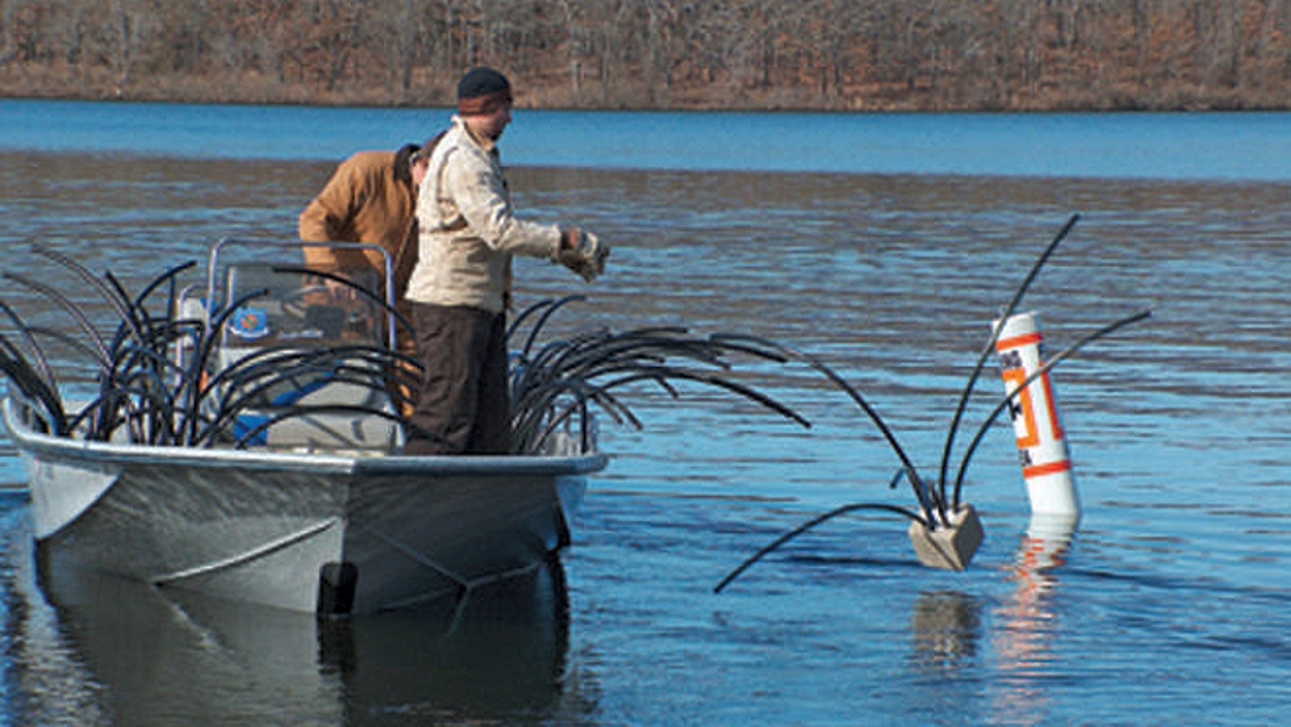 """Debris from the recent tornado that swept through Oklahoma is being put to use by state conservation officials, who are submerging it in lakes to form """"fish attractors."""""""