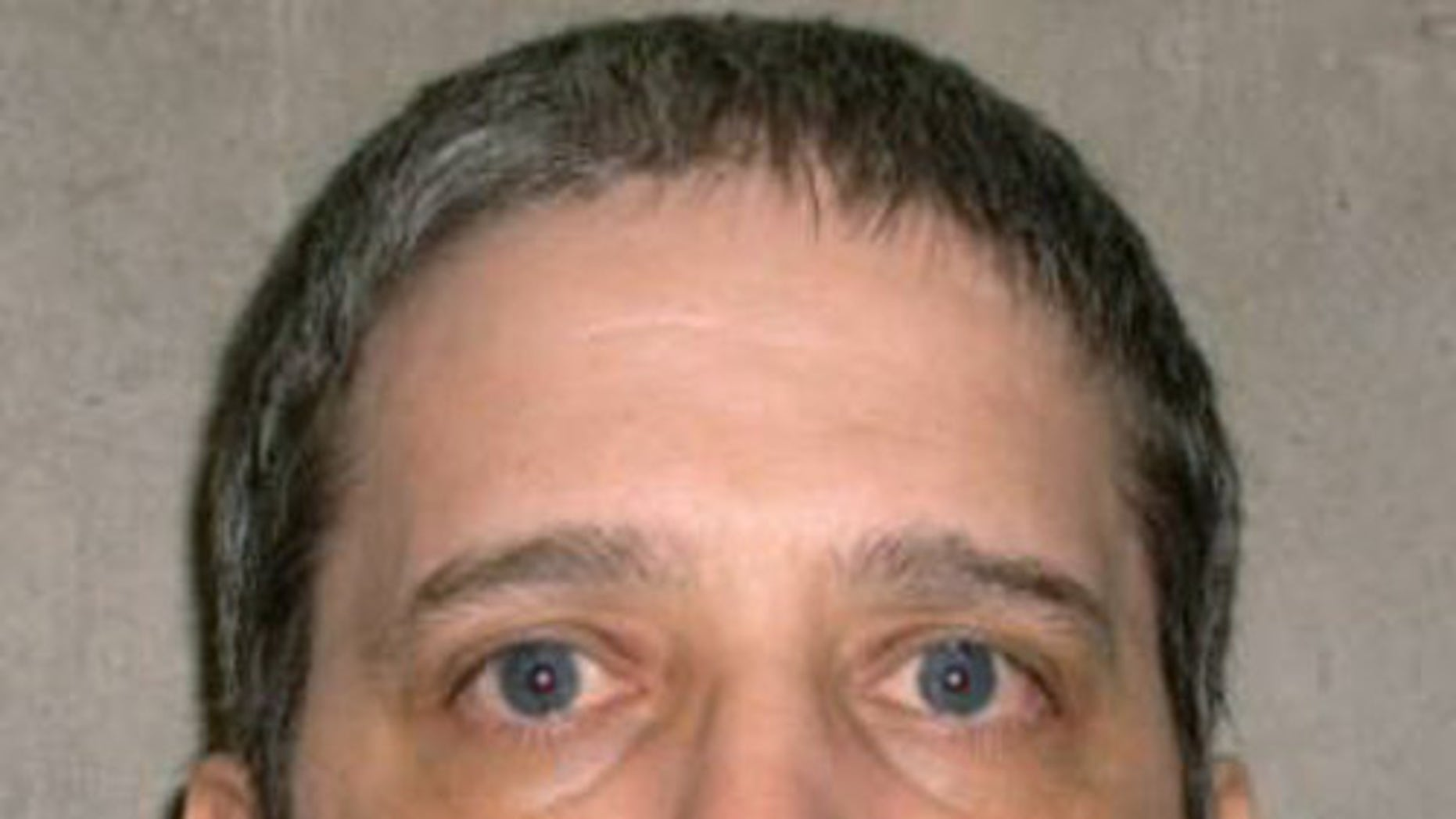 FILE- This undated file photo provided by the Oklahoma Department of Corrections shows Richard Glossip. Glossip is scheduled to be executed Jan. 29, 2015. Oklahoma is willing to put three executions on hold while the U.S. Supreme Court reviews whether a certain sedative can render death row inmates sufficiently unconscious, the state's attorney general said in a Monday filing with the court. (AP Photo/Oklahoma Department of Corrections, File)