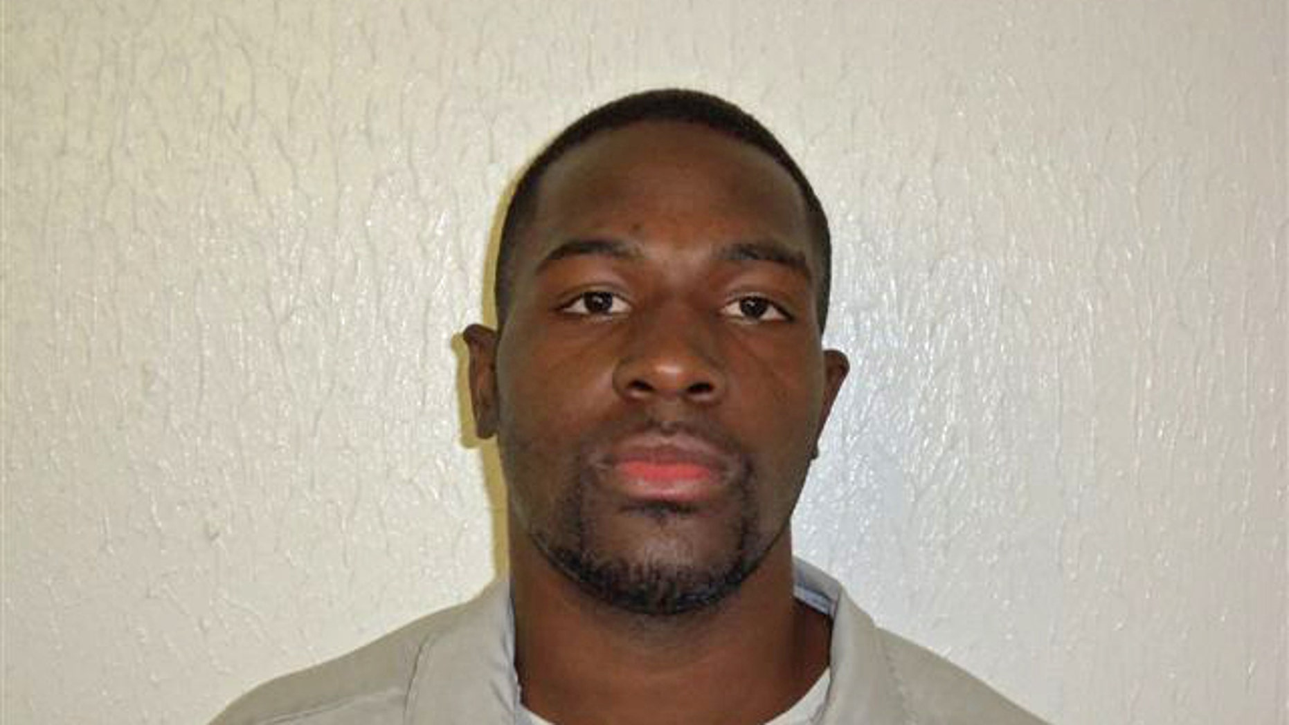 This March 21, 2011 photo provided by the Oklahoma Department of Corrections shows Alton Nolen, of Moore, Okla. Prison records indicate that Nolen, the suspect in the beheading of a co-worker at an Oklahoma food processing plant Thursday, Sept. 25, 2014, had spent time in prison and was on probation for assaulting a police officer. (AP Photo/Oklahoma Department of Corrections)