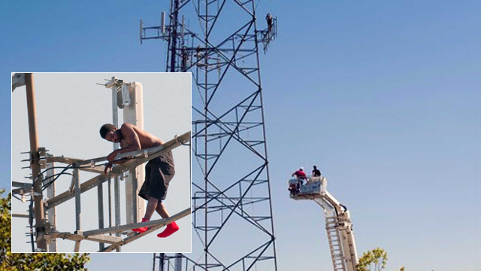 Aug. 14: Negotiators in a firetruck ladder bucket attempt to make contact with the man in the tower.