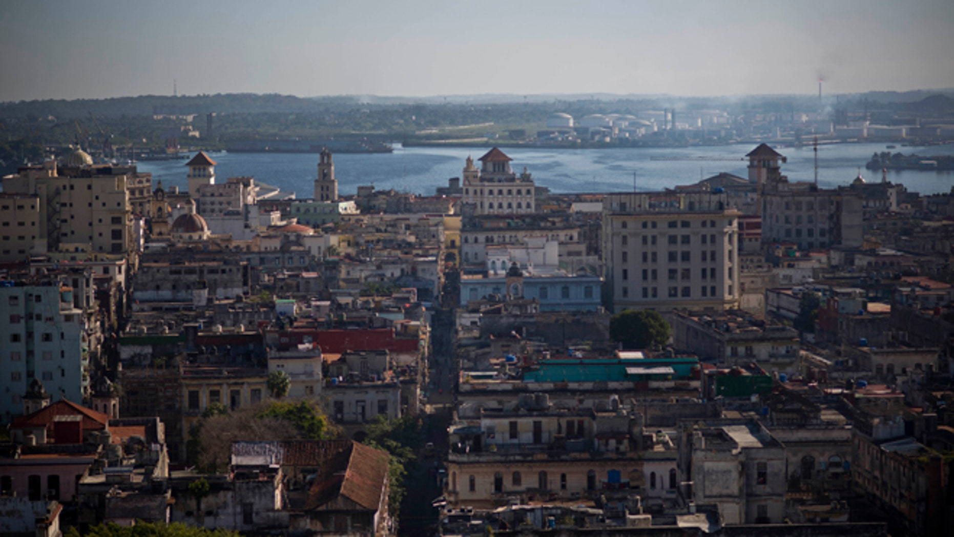 This Dec. 30, 2014 photo shows Havana from the capitol dome in Havana, Cuba. Everyone warns you Old Havana is a facade, but it's impossible not to be taken by its charms. For a foreigner who isn't coming with predetermined notions of Cuba as global boogeyman or socialist paradise, each alley and avenue, each conversation with a Cuban, complicates the picture. (AP Photo/Ramon Espinosa)