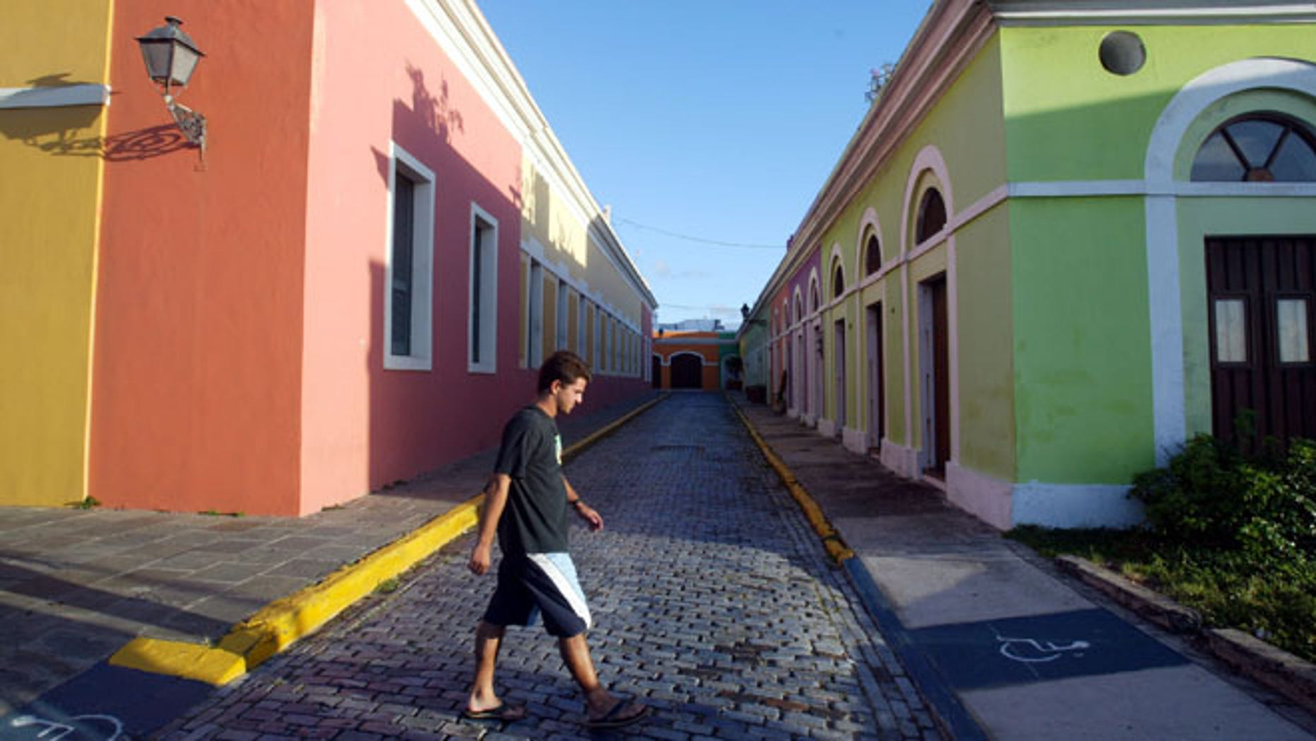 SAN JUAN, PUERTO RICO- APRIL 25: Colorful homes line the cobblestoned streets April 25, 2004 in Old San Juan, the original capital city of San Juan, Puerto Rico. The old city is a historic district of seven square blocks made up of ancient buildings and colonial homes, massive stone walls and vast fortifications, sunny parks and cobblestoned streets.  (Photo by Joe Raedle/Getty Images)