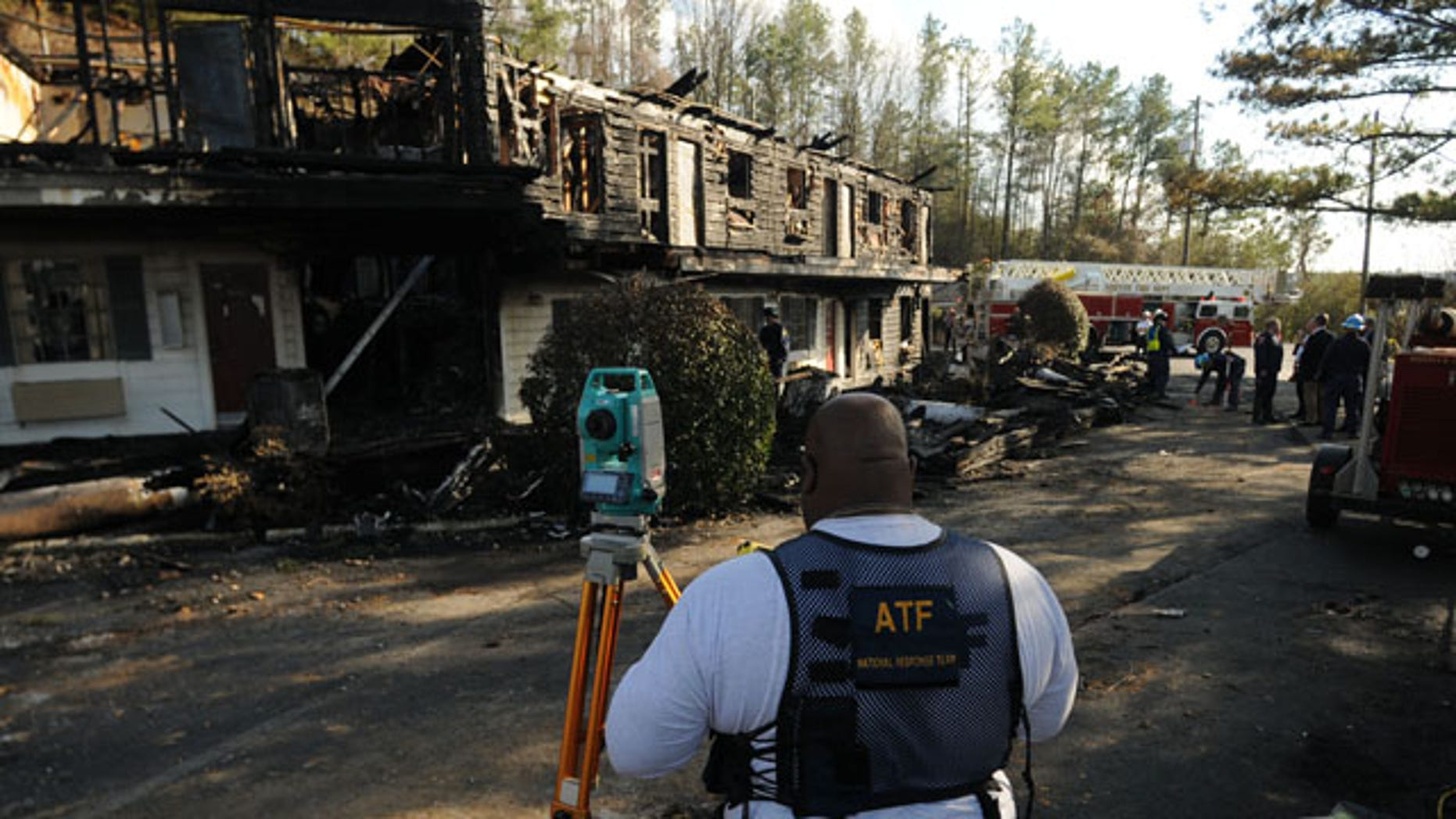 In this Jan. 18, 2010 photo, an investigator with the Bureau of Alcohol, Tobacco, Firearms and Explosives works at the site of a fatal fire which killed four Mississippi college students at the Days Inn in Hoover, Ala. (AP)