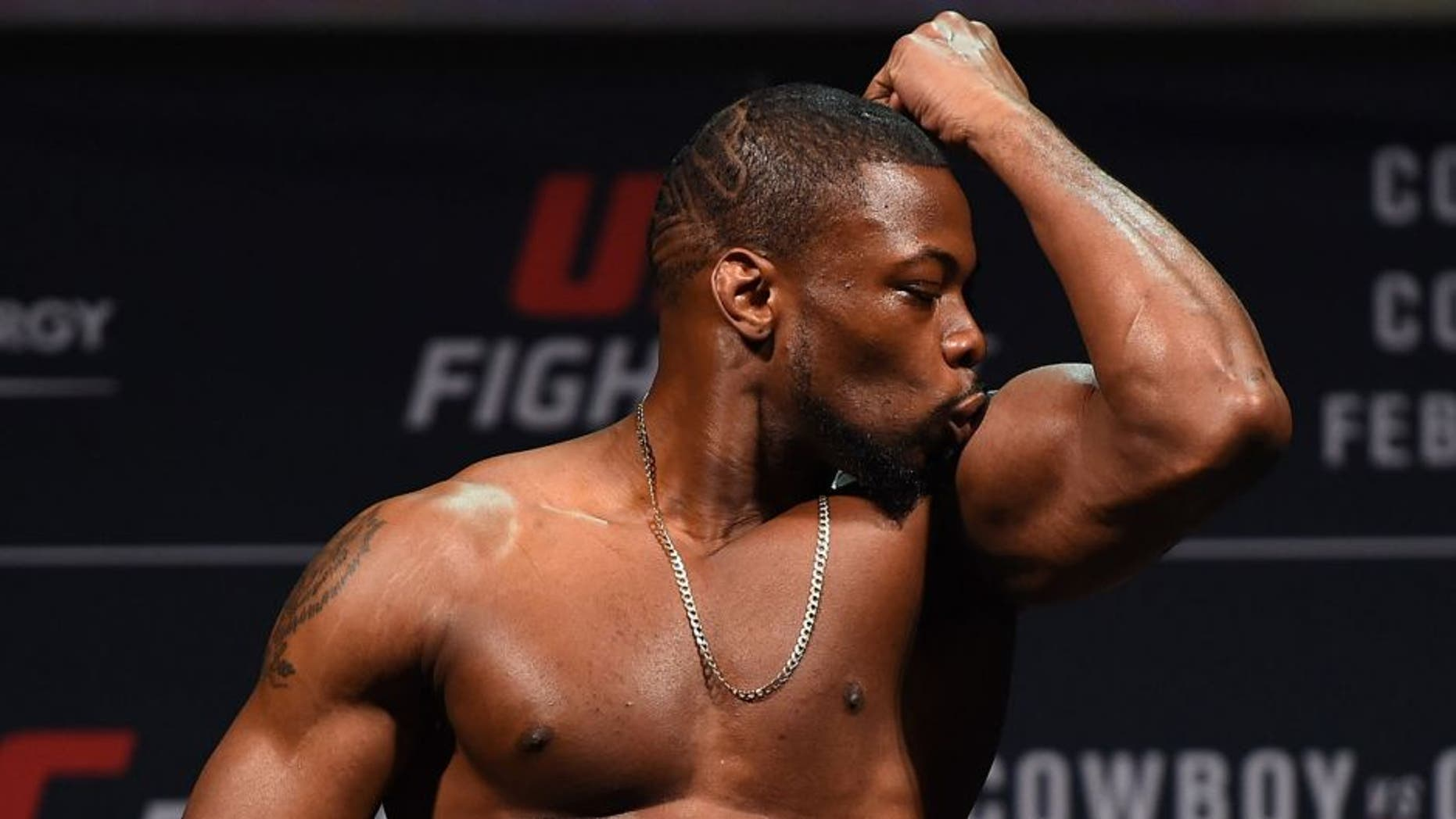 PITTSBURGH, PA - FEBRUARY 20: Oluwale Bamgbose of the United States steps on the scale during the UFC Fight Night weigh-in at Stage AE on February 20, 2016 in Pittsburgh, Pennsylvania. (Photo by Jeff Bottari/Zuffa LLC/Zuffa LLC via Getty Images)