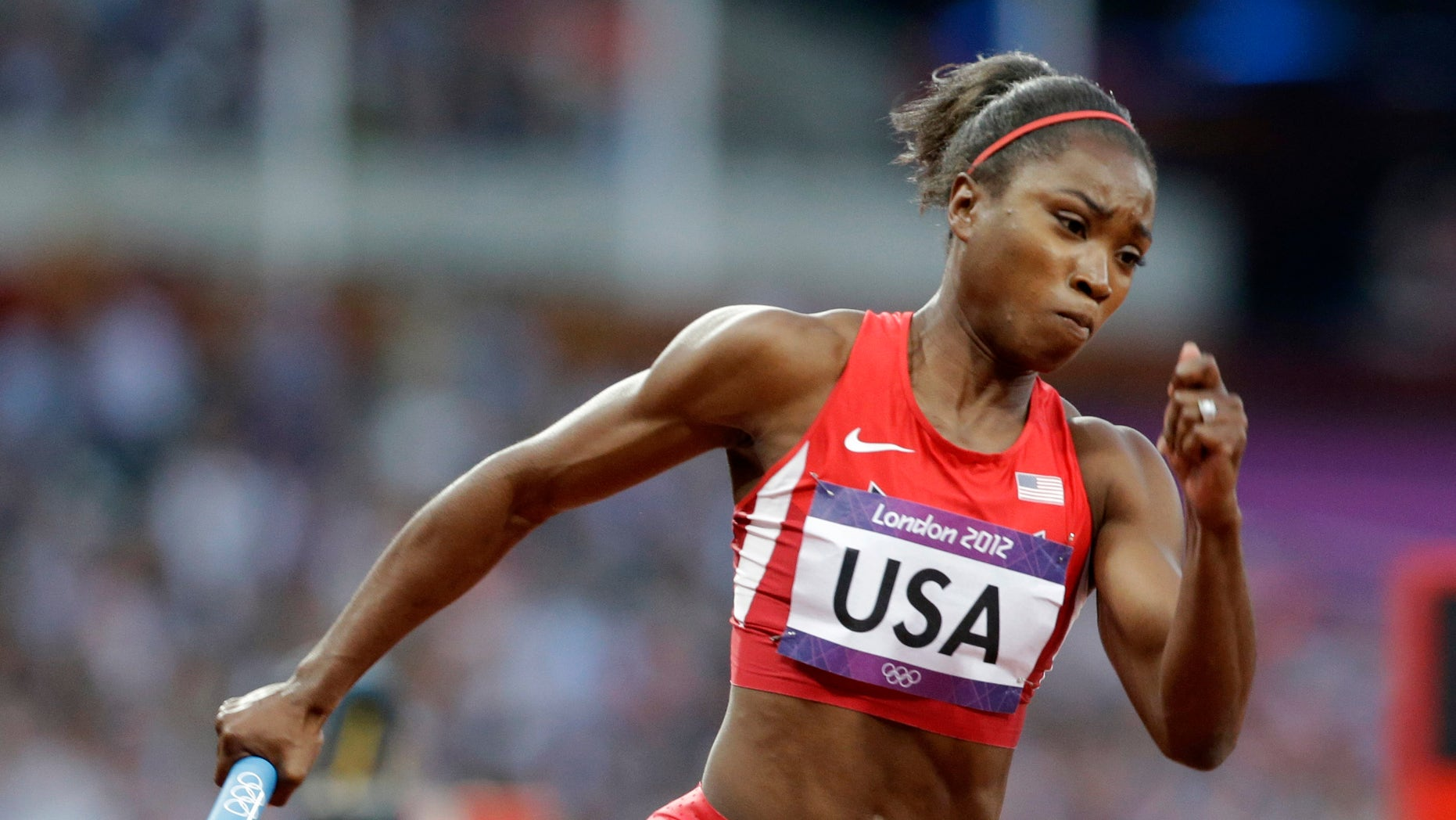 Aug. 9, 2012: In this file photo, United States' Tianna Madison runs in the first leg of the women's 400-meter relay heat at the Summer Olympics in London.