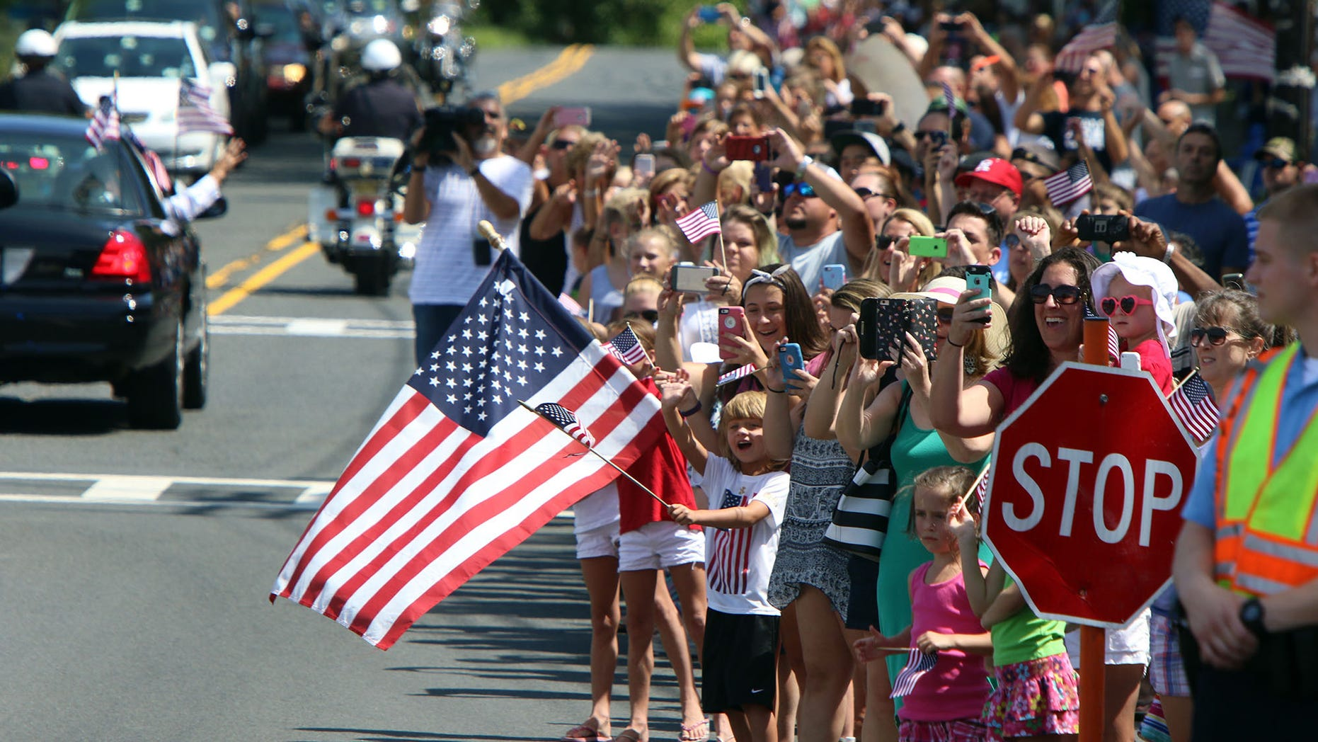 People wave and hold flags during a parade for Olympic gymnast Laurie Hernandez on Saturday, Aug. 27, 2016, in Old Bridge, N.J. (Magdeline Bassett/The Asbury Park Press via AP)