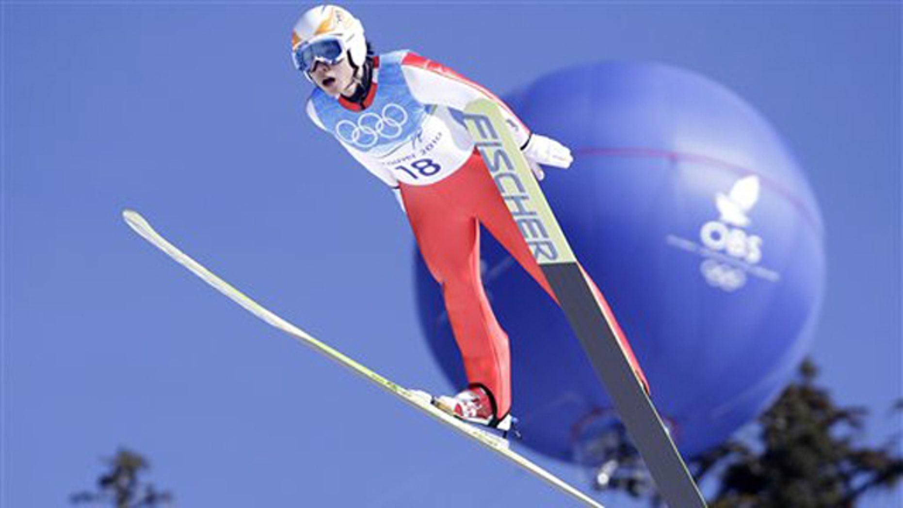 Korea's Kim Hyun-Ki makes an attempt during Men's large hill ski jumping training session at the Vancouver 2010 Olympics.