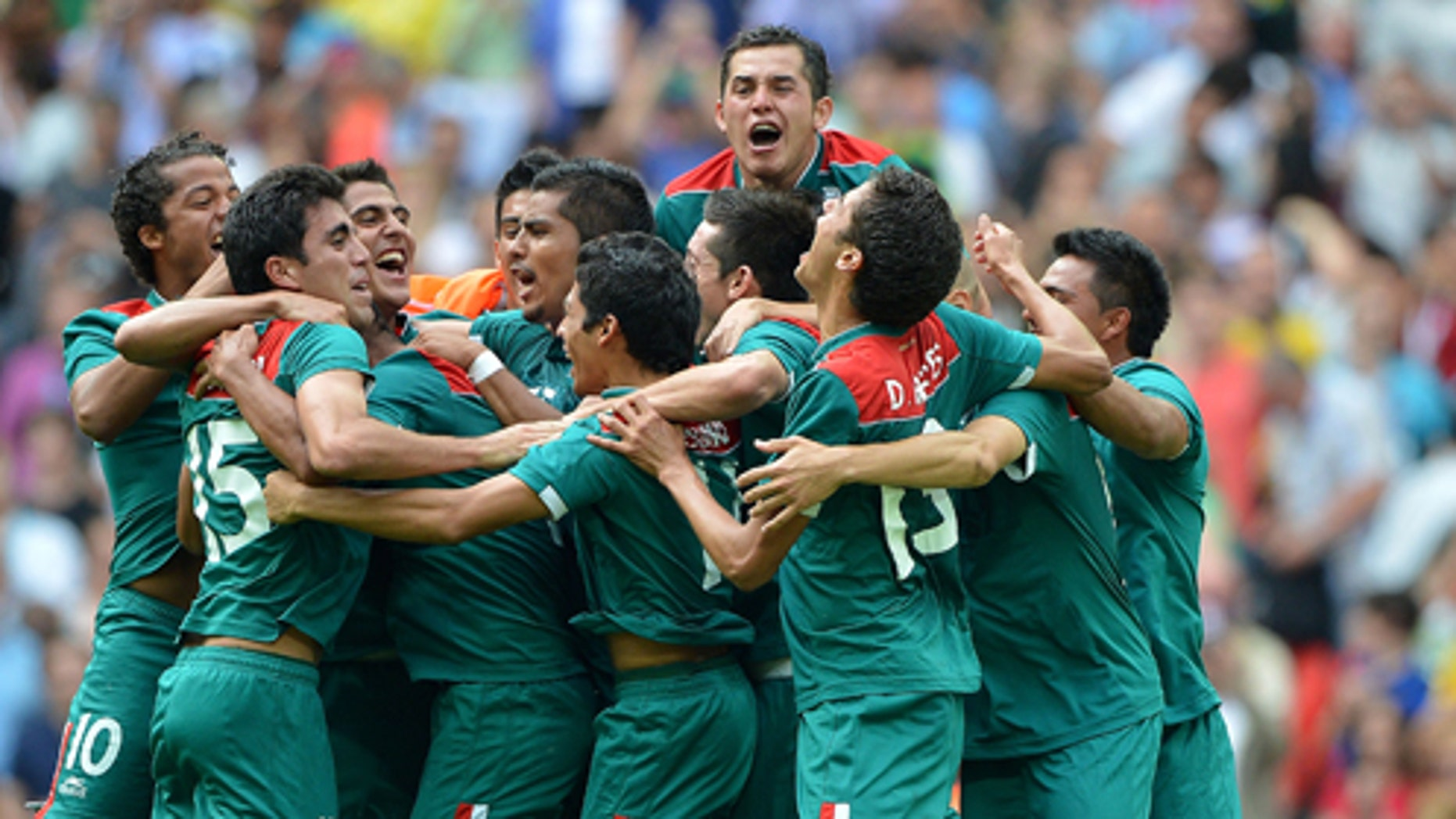 LONDON, ENGLAND - AUGUST 11:  Mexico players celebrate after winning gold in the Men's Football Final between Brazil and Mexico on Day 15 of the London 2012 Olympic Games at Wembley Stadium on August 11, 2012 in London, England.  (Photo by Jeff J Mitchell/Getty Images)