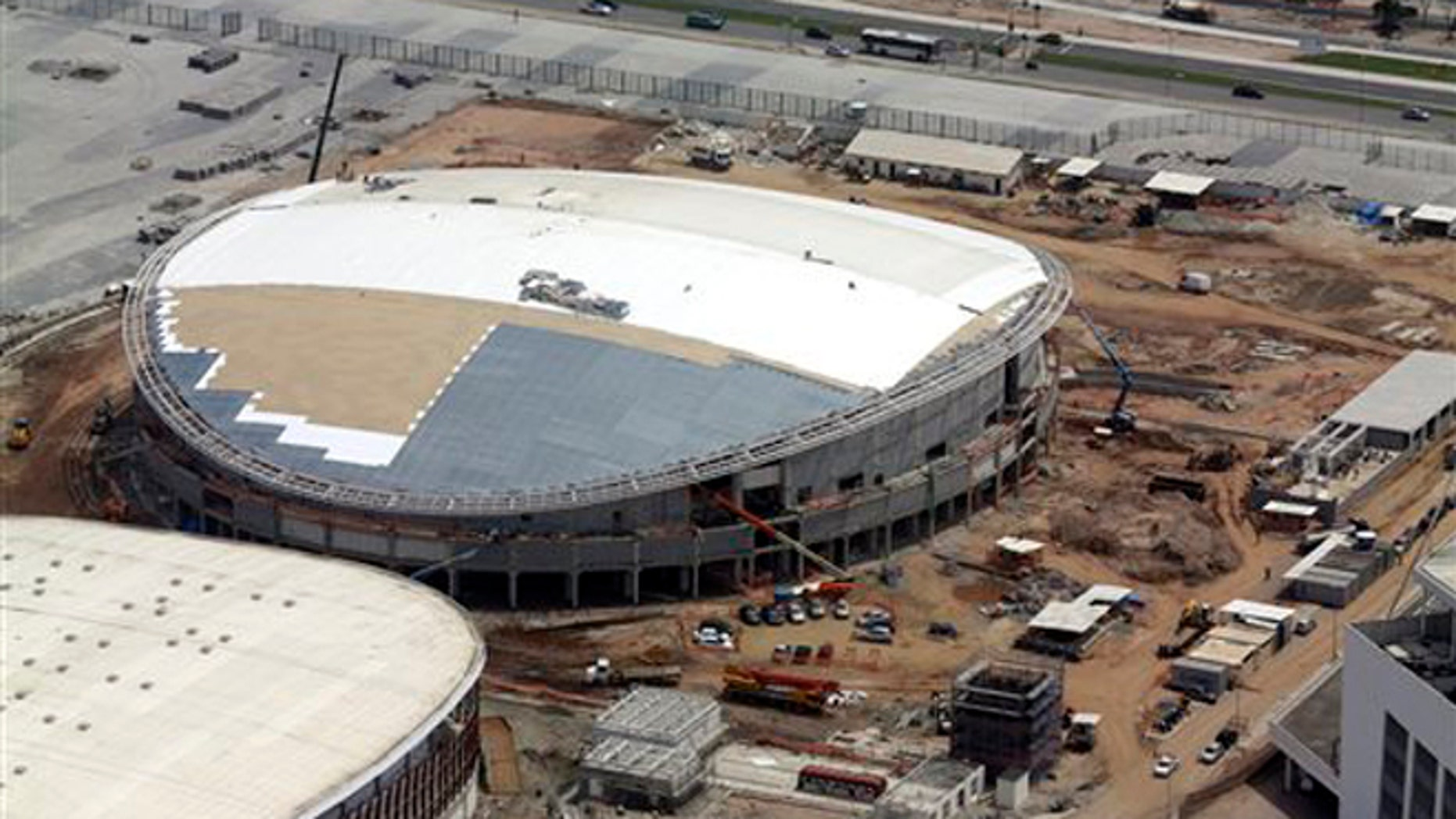 FILE - In this Oct. 9, 2015, file aerial photo, construction continues at the Rio Olympics velodrome in Rio de Janeiro. The president of cyclings world governing body remains very, very concerned that the velodrome under construction for the Rio Olympics will not be completed by the opening in August.  (AP Photo/David J. Phillip, File)