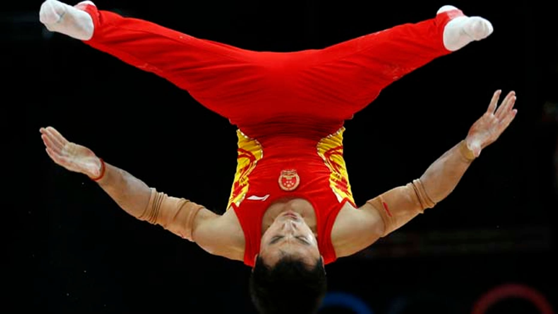July 30, 2012: Chinese gymnast Feng Zhe performs on the parallel bars during the Artistic Gymnastic men's team final at the 2012 Summer Olympics, in London.