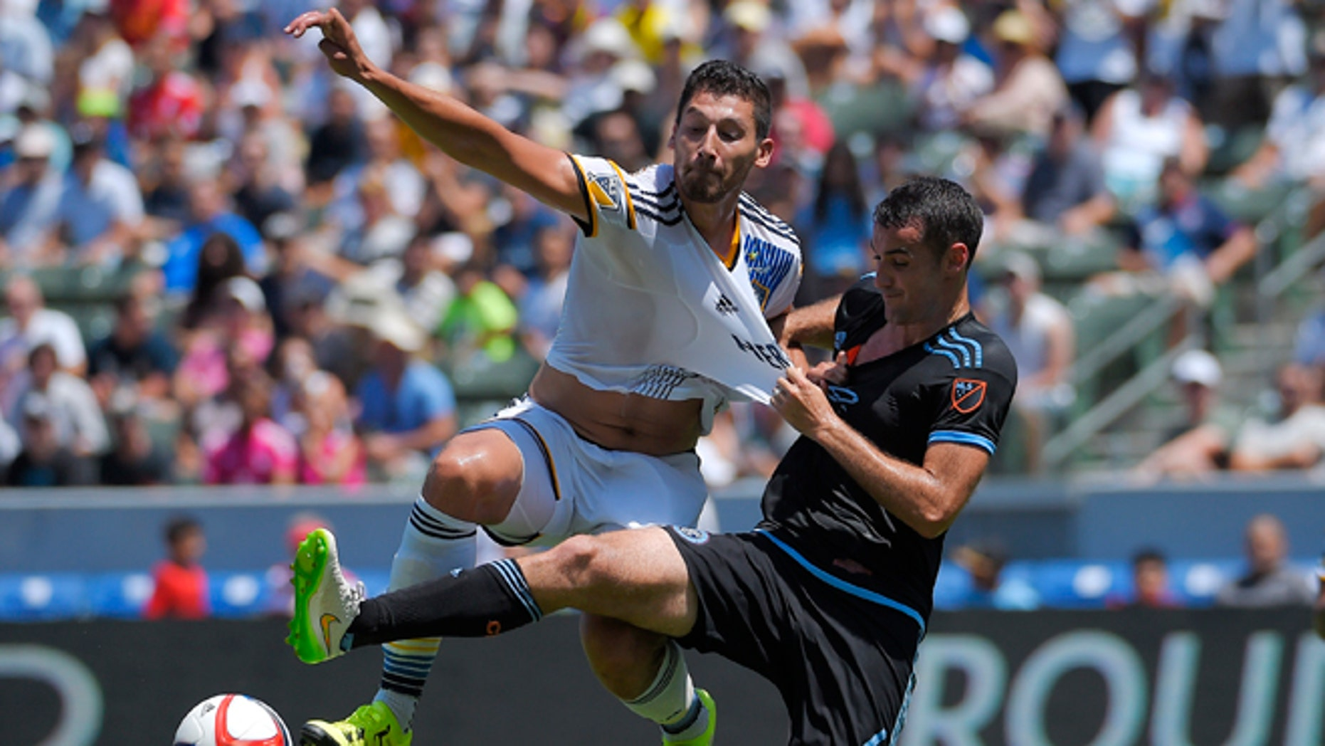 FILE - In this Aug. 23, 2015, file photo, Los Angeles Galaxy defender Omar Gonzalez, left, and New York City FC midfielder Andrew Jacobson battle for the ball during the first half of an MLS soccer match in Carson, Calif. Gonzalez has been transferred from the Galaxy to Mexicoâs Pachuca. The Galaxy announced the move Tuesday, Dec. 22. (AP Photo/Mark J. Terrill, File)