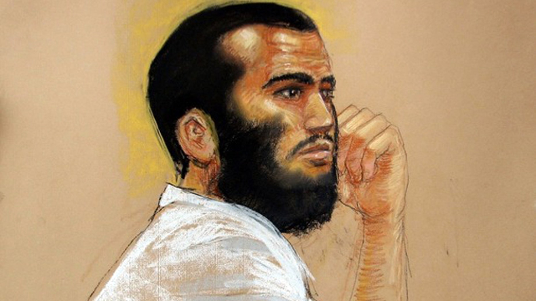 April 28, 2010: Sketch by courtroom artist Janet Hamlin shows Canadian defendant Omar Khadr attends a hearing in the courthouse for the U.S. military war crimes commission at the Camp Justice compound on Guantanamo Bay U.S. Naval Base in Cuba.