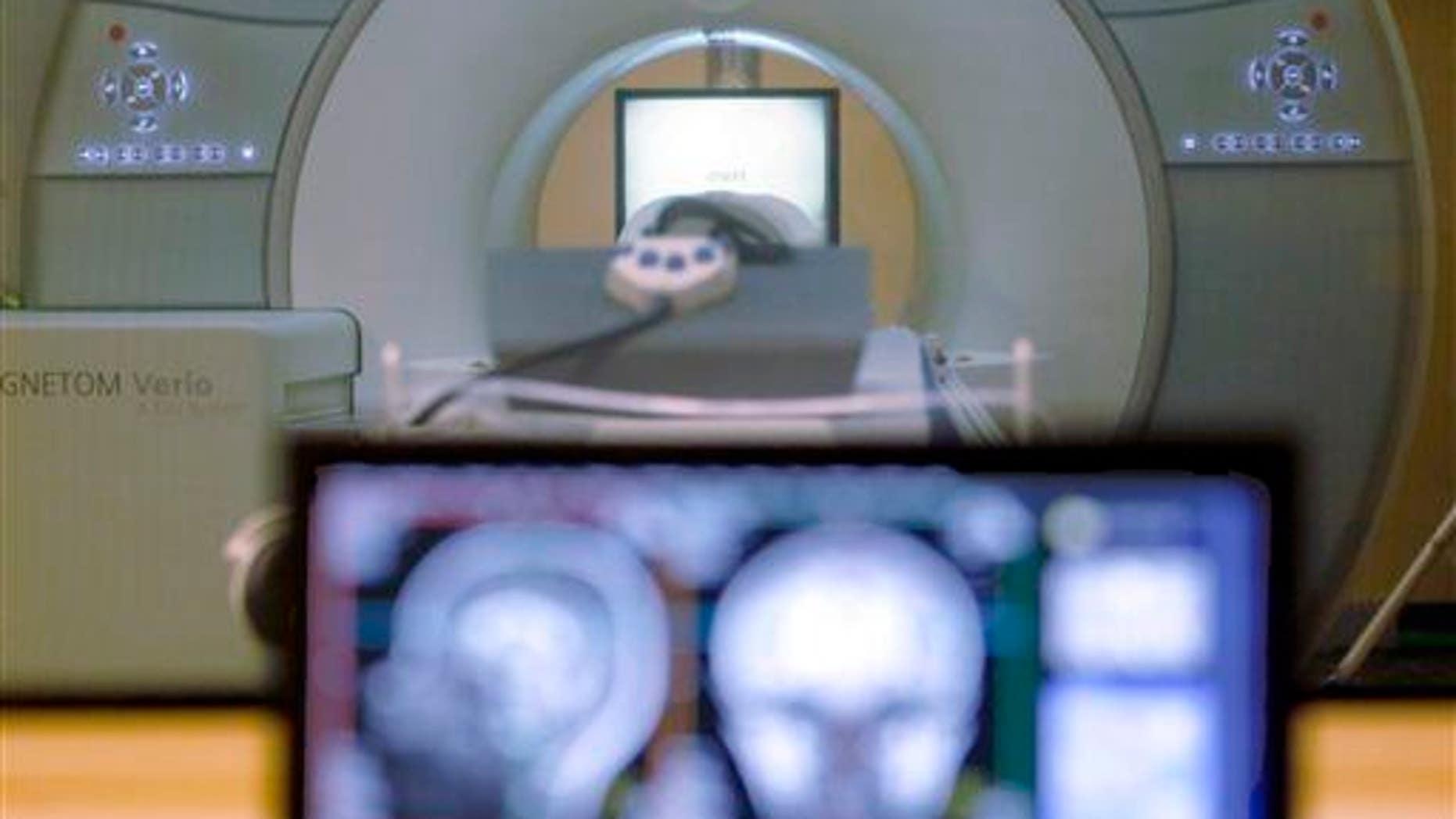 A brain-scanning MRI machine is shown.