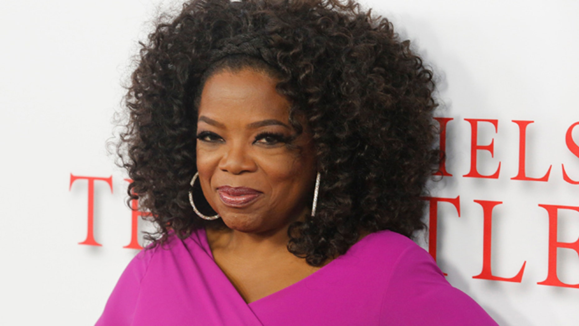 "Actress Oprah Winfrey, a cast member of the film ""Lee Daniels' The Butler"", poses at the film's premiere in Los Angeles August 12, 2013. REUTERS/Fred Prouser (UNITED STATES - Tags: ENTERTAINMENT) - RTX12J97"