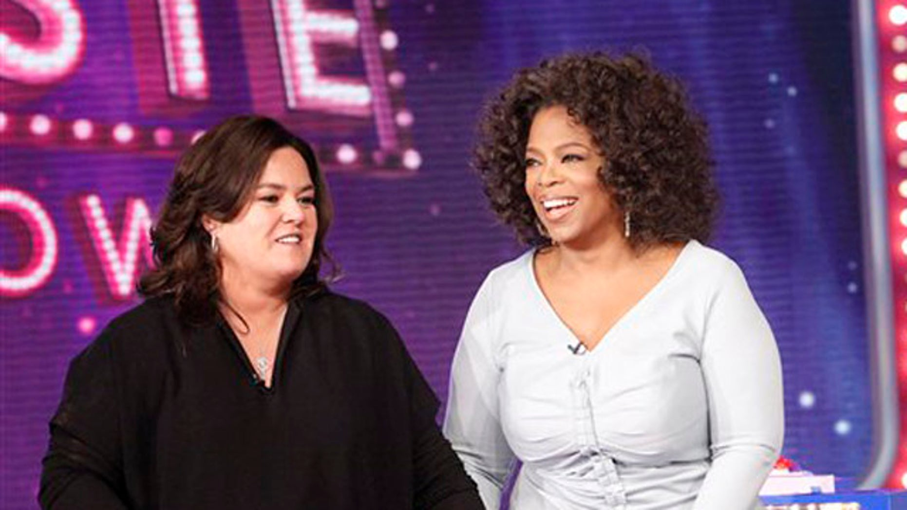 """Oct. 10, 2011: In this file image released by Harpo, Inc., Oprah Winfrey, right, is shown with host Rosie O'Donnell during the debut of """"The Rosie Show"""" in Chicago."""