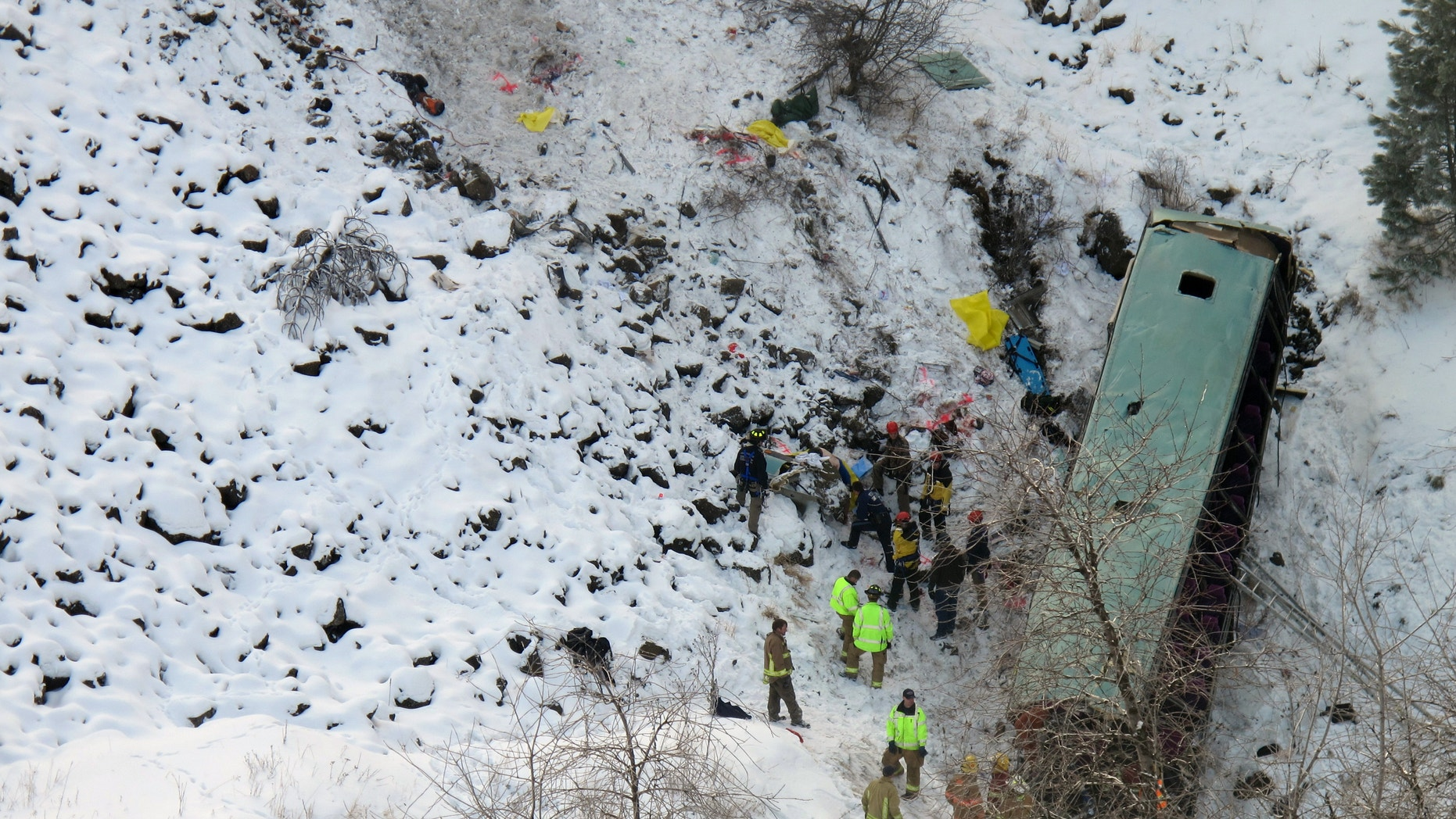 Dec. 30, 2012: Emergency personnel respond to the scene of a multiple fatality accident where a tour bus careened through a guardrail along an icy Oregon highway and fell several hundred feet down a steep embankment.