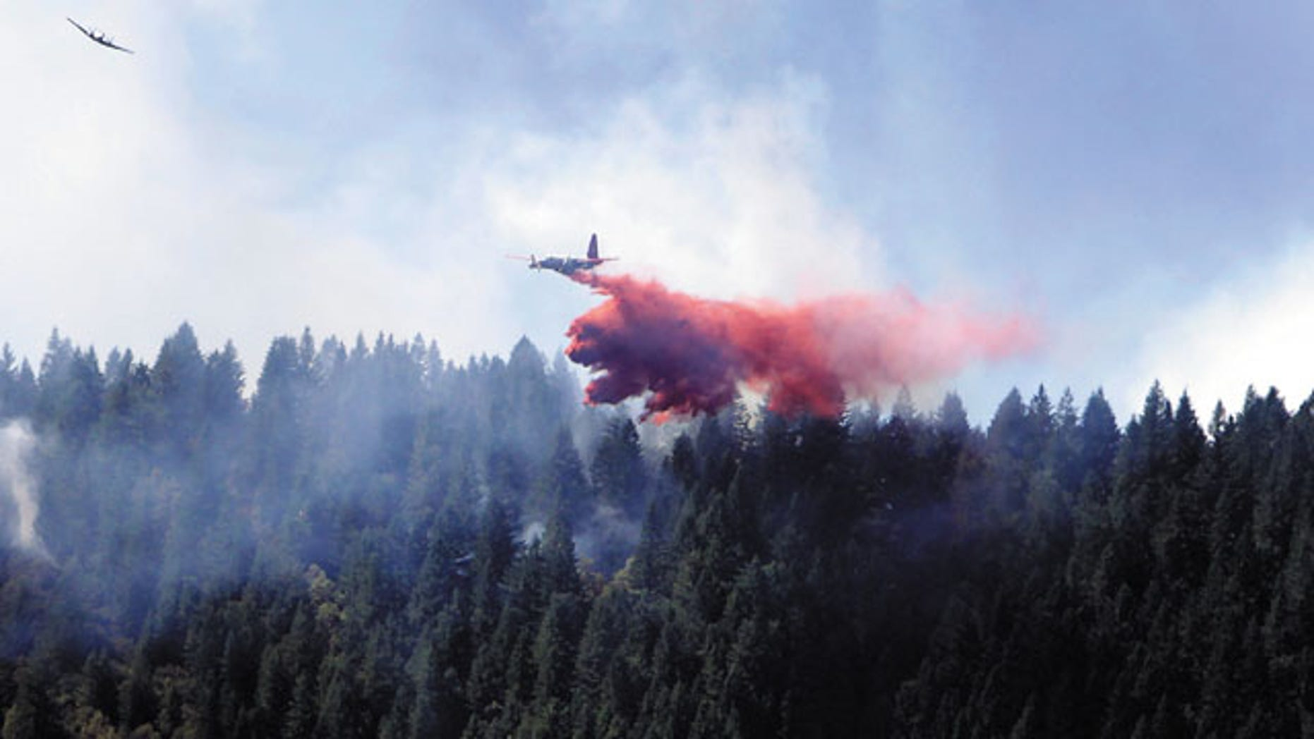 July 28, 2013: A fire-bomber and guide plane make a pass near Rattlesnake Creek in Glendale, Ore.