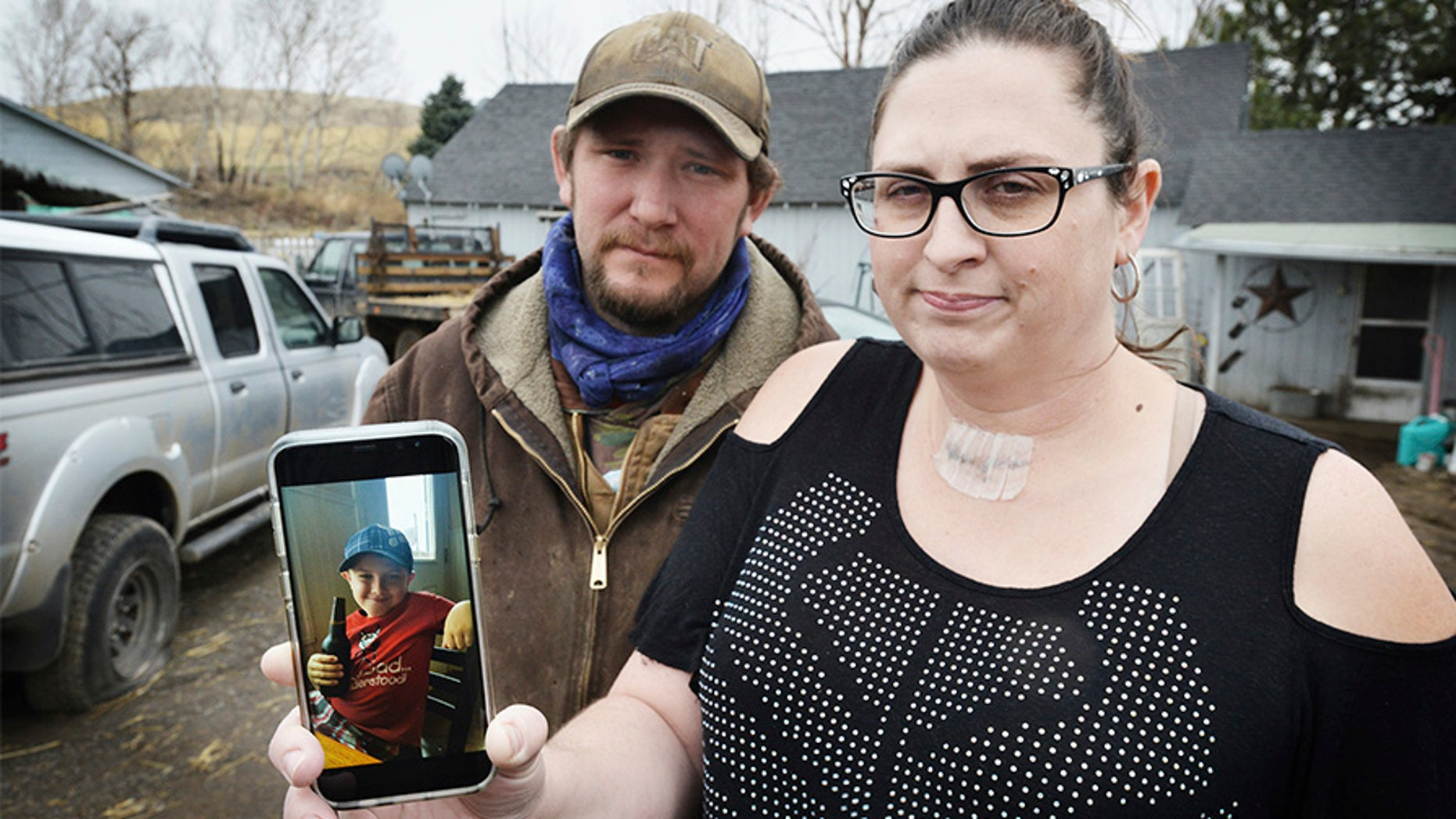 Scott Hinkle, left, and Sara Hebard, both of Pilot Rock, Oregon, lost their son, Liam Flanagan, 8, pictured in the cell phone photo, on Saturday, Jan. 21, 2018, after an eight-day battle with a flesh-eating bacteria.  (E.J. Harris /East Oregonian via AP)
