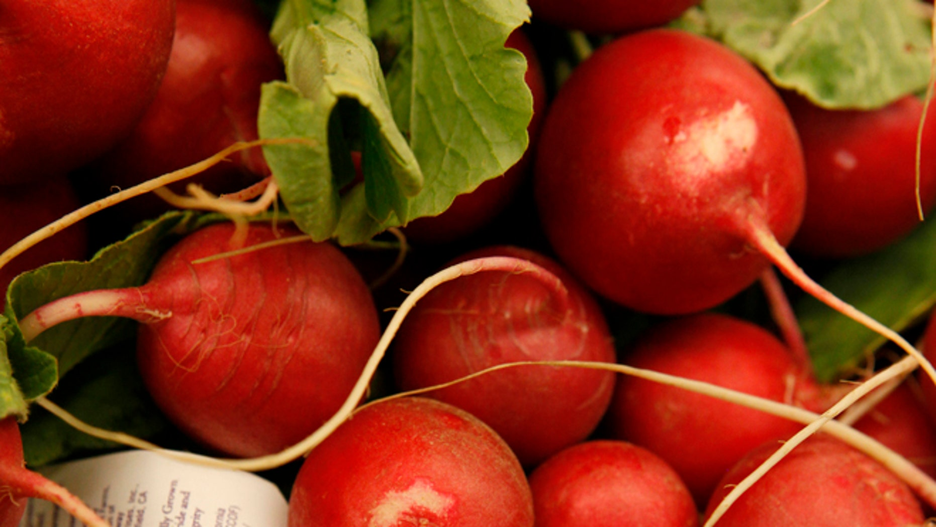 This March 16, 2011, file photo shows organic radishes at the Pacifica Farmers Market in Pacifica, Calif. AP Photo, File)