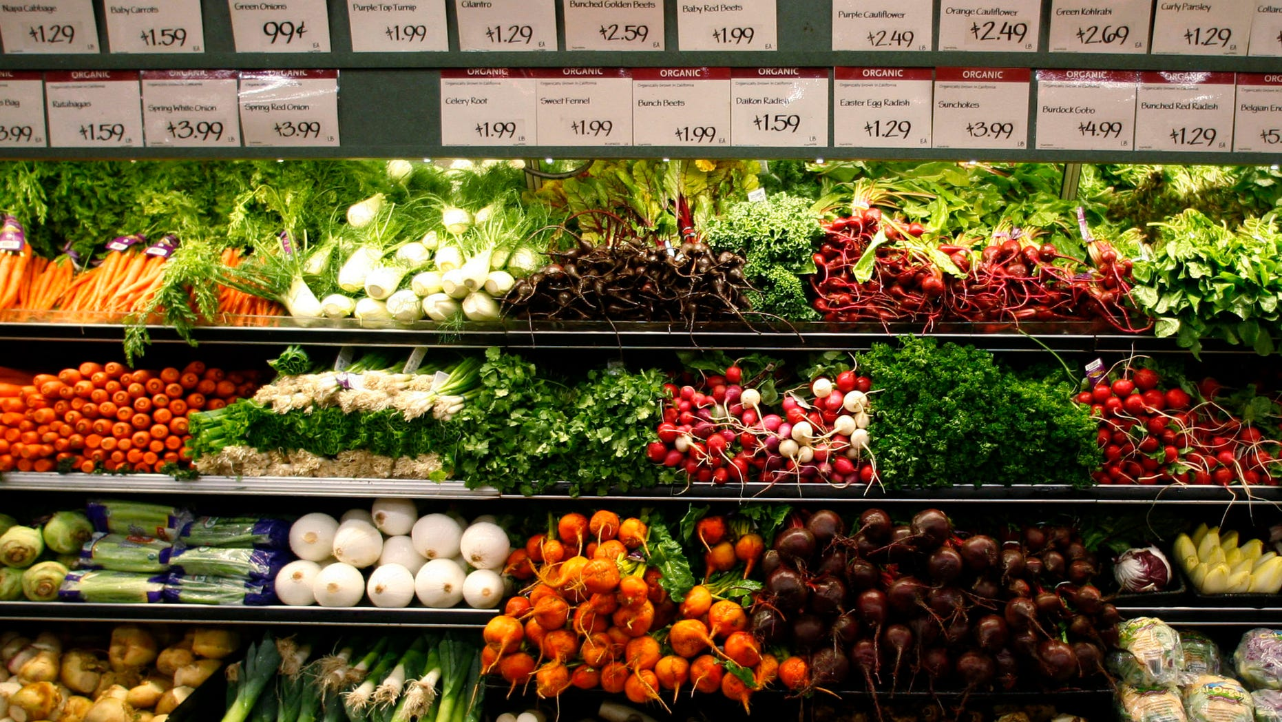 Organic vegetables are shown at a  Whole Foods Market  in LaJolla, California in this May 13, 2008 file photo. As recession tests the middle-class commitment to healthy eating and environmentally sound farming, sales of organic food are slowing, but so far not falling. How green are our wallets? To match feature FINANCIAL/FOOD-ORGANIC      REUTERS/Mike Blake/Files      (UNITED STATES) - RTR23YED