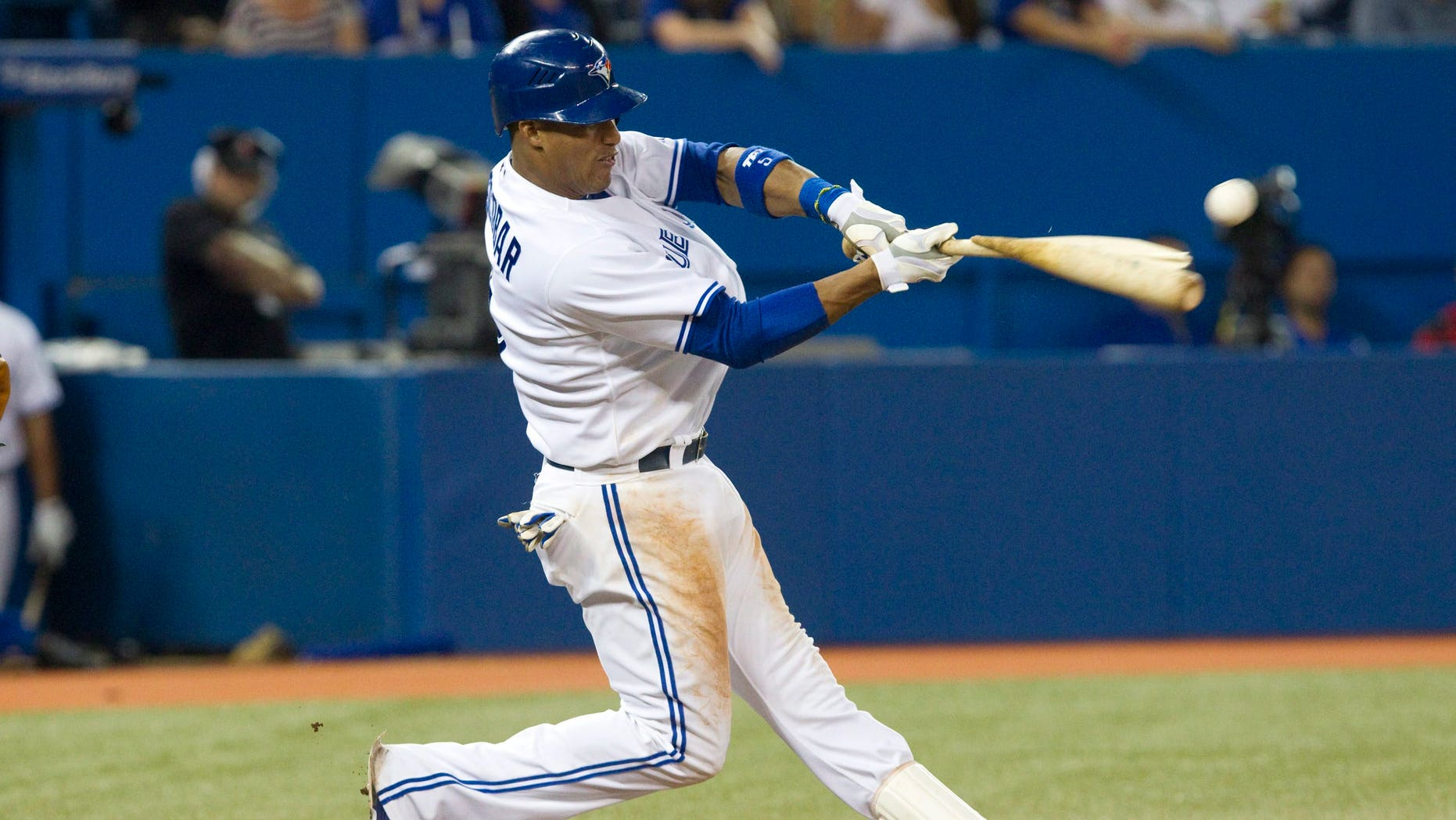 Sept. 5, 2012: Toronto Blue Jays' Yunel Escobar breaks his bat as he hits a double off a ball from Baltimore Orioles pitcher Miguel Gonzalez during the seventh inning of baseball game action in Toronto.