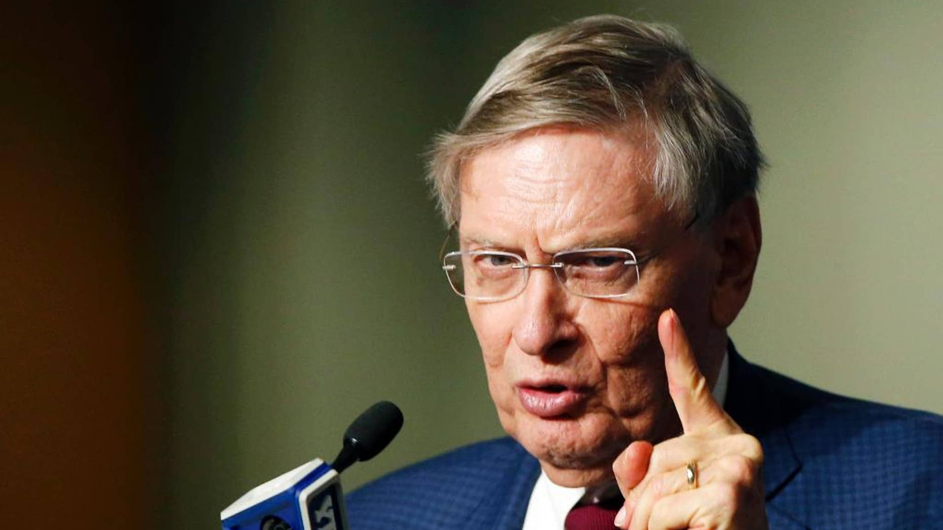 Major League Baseball Commissioner Bud Selig speaks to the media before a baseball game between the New York Yankees and the Baltimore Orioles at Yankee Stadium in New York, Tuesday, Sept. 23, 2014. (AP Photo/Kathy Willens)