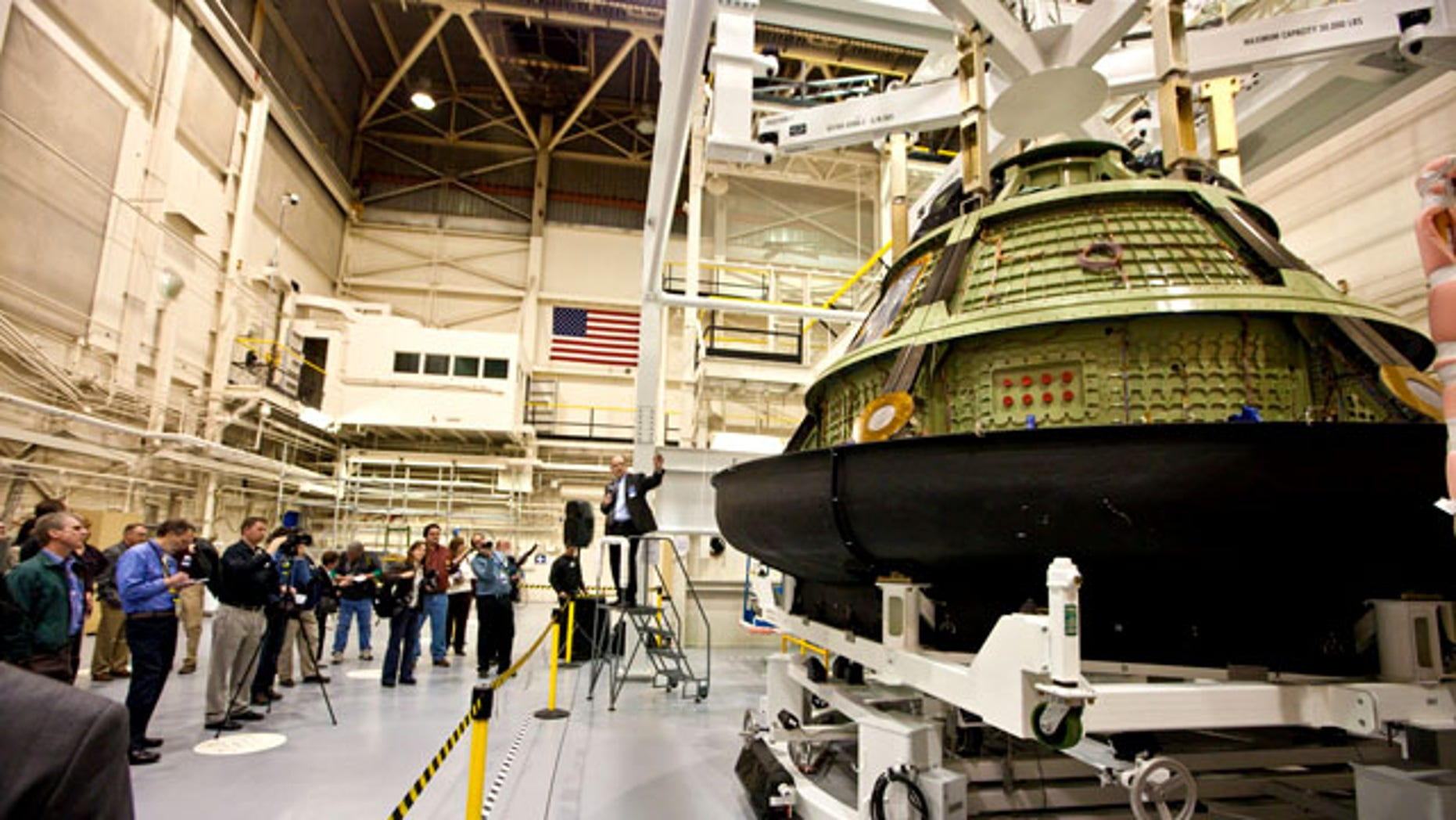 Jim Bray, Orion Crew and Service Module Director, explains how the Orion crew module will be integrated with the backshell and heat shield structure prior to acoustic and vibration testing. The spacecraft is being prepared to undergo rigorous acoustic and vibration testing to validate Orions ability to endure the harsh environments of deep space.
