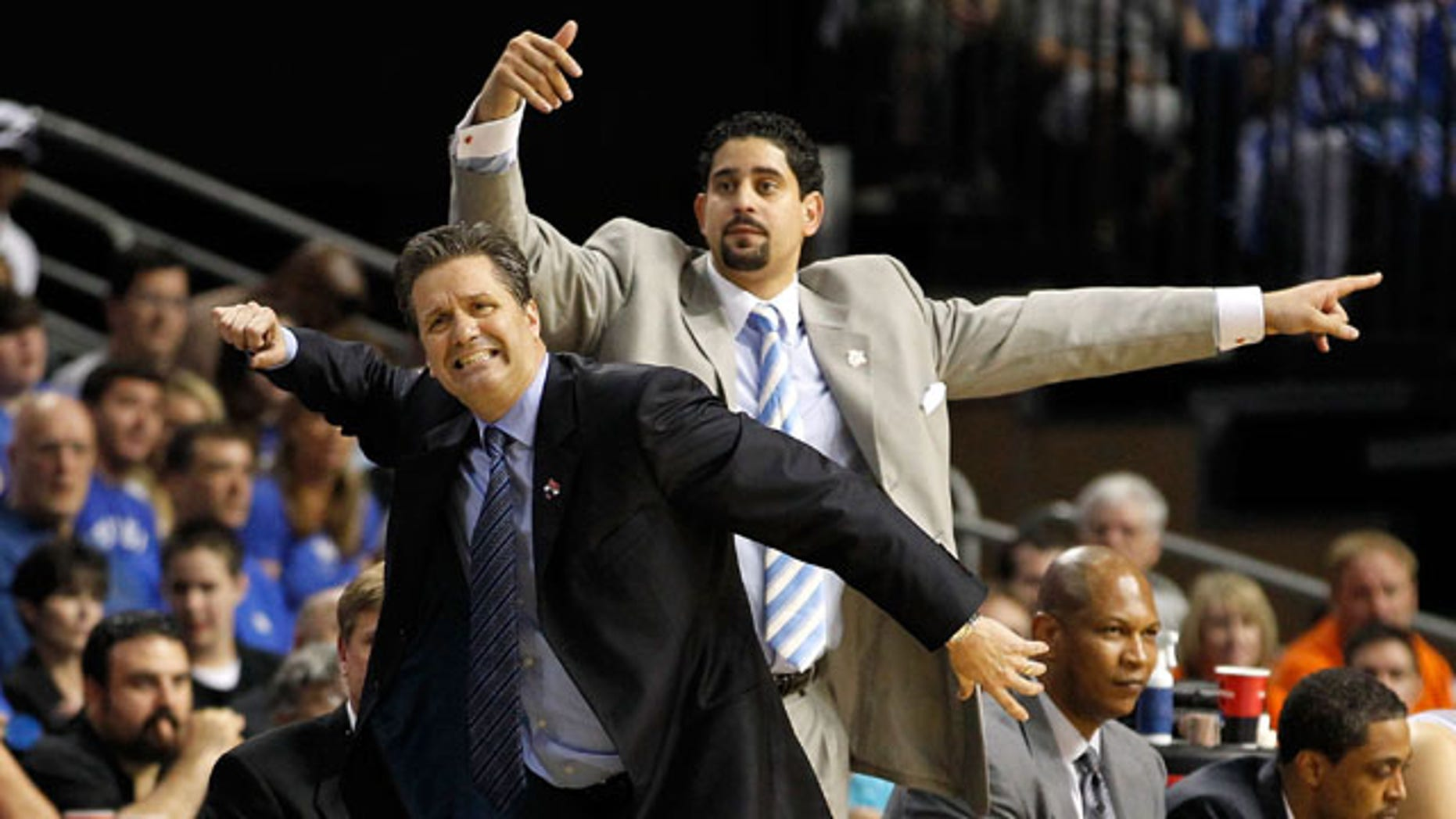 TAMPA, FL - MARCH 19:  (L-R)  Head coach John Calipari and assistant coach Orlando Antigua of the Kentucky Wildcats react as they coach against the West Virginia Mountaineers  during the third round of the 2011 NCAA men's basketball tournament at St. Pete Times Forum on March 19, 2011 in Tampa, Florida.  (Photo by J. Meric/Getty Images) *** Local Caption *** John Calipari; Orlando Antigua