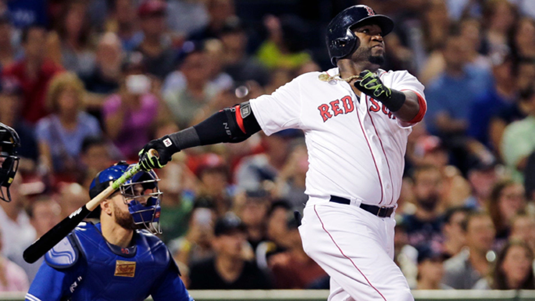 Boston Red Sox designated hitter David Ortiz watches his 498th career home run, off Toronto Blue Jays starting pitcher Drew Hutchison during the third inning of a baseball game at Fenway Park in Boston, Wednesday, Sept. 9, 2015. (AP Photo/Charles Krupa)