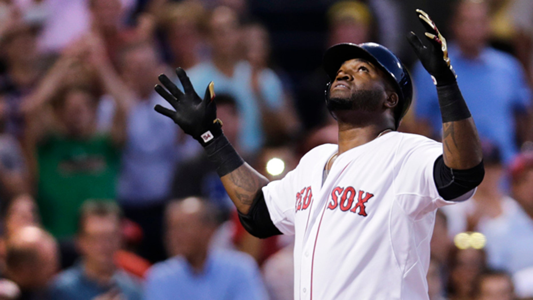 Boston Red Sox designated hitter David Ortiz reacts as he crosses home plate after his solo home run off Cleveland Indians starting pitcher Corey Kluber during the second inning of a baseball game at Fenway Park in Boston, Wednesday, Aug. 19, 2015. (AP Photo/Charles Krupa)