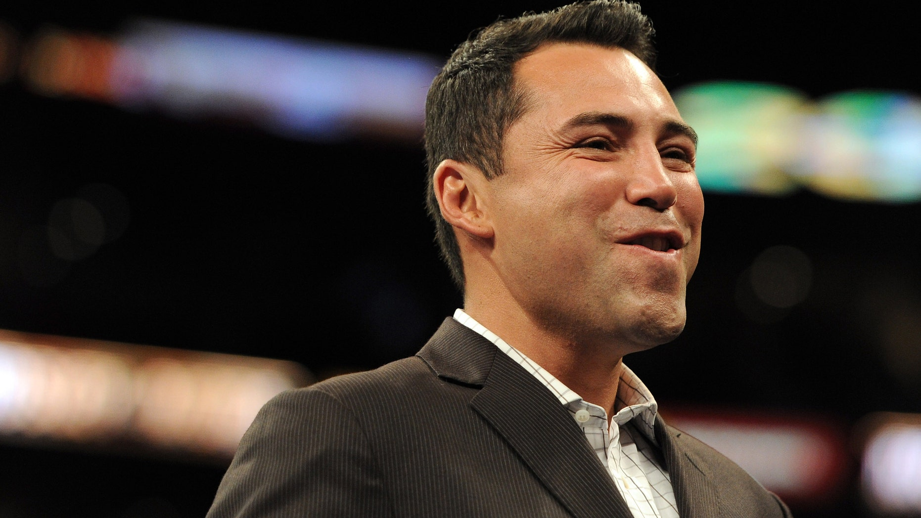 LOS ANGELES, CA - SEPTEMBER 18:  Oscar de la Hoya smiles before the Middleweight bout against Shane Mosley and Sergio Mora at Staples Center on September 18, 2010 in Los Angeles, California.