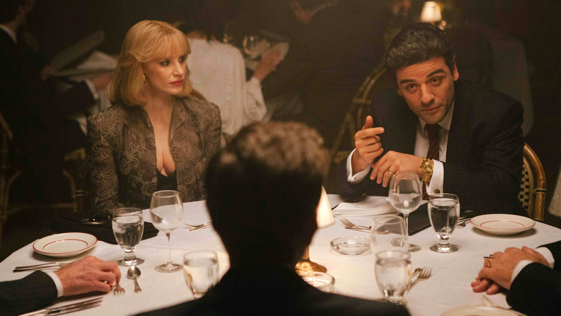 "In this image released by A24 Films, Jessica Chastain, left, and Oscar Isaac appear in a scene from ""A Most Violent Year."" Chastain was nominated for a Golden Globe for best supporting actress in a drama for her role in the film on Thursday, Dec. 11, 2014. The 72nd annual Golden Globe awards will air on NBC on Sunday, Jan. 11. (AP Photo/A24 Films, Atsushi Nishijima)"
