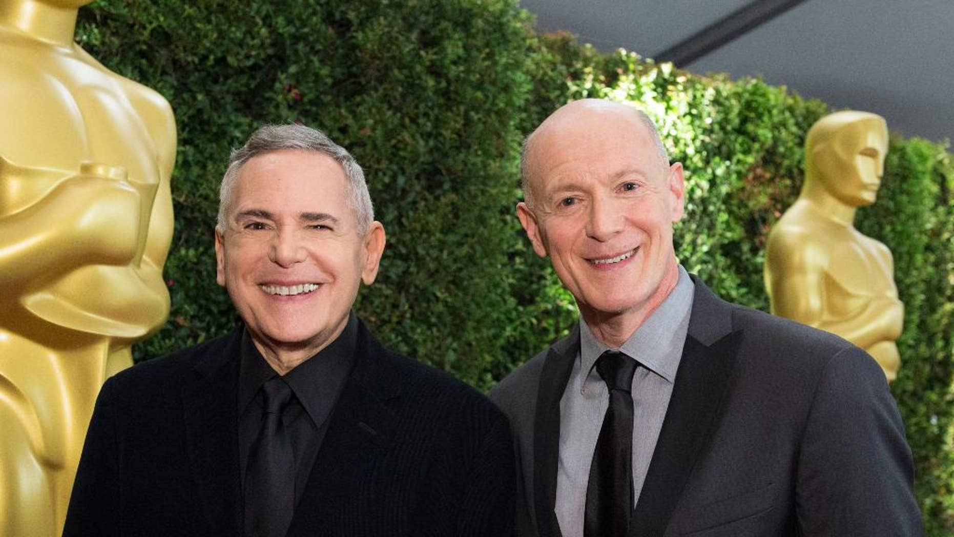 This Nov. 16, 2013 photo provided by courtesy of the Academy of Motion Picture Arts and Sciences shows producers Craig Zadan, left,  and Neil Meron attending the 2013 Governors Awards at The Ray Dolby Ballroom at Hollywood & Highland Center in Hollywood, Calif. The producers, Zadan and Meron, tell us what and what not to expect on this year's Oscar show and how they're keeping it fresh after three years on the job. The 87th annual Academy Awards are presented on Sunday, Feb. 22, 2015, in Los Angeles. (AP Photo/AMPAS, Richard Harbaugh)